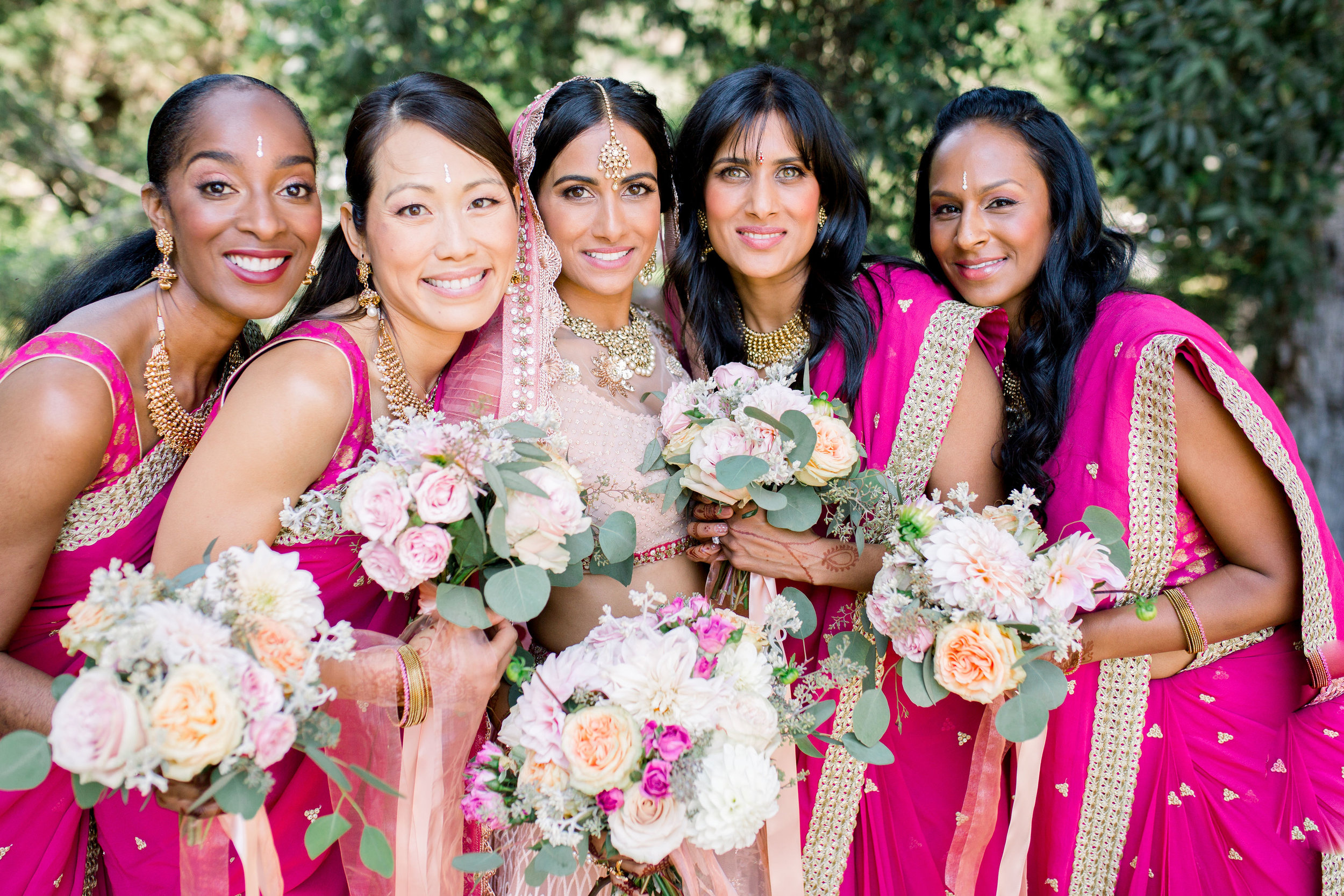 We are obsessed with the bright colors! Uma and her bridesmaids look stunning.