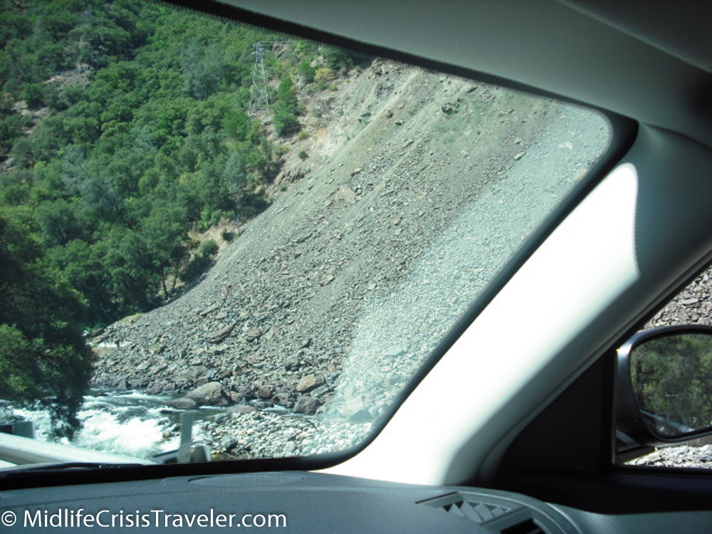 The rockslide destroyed the road on the right side of the river.