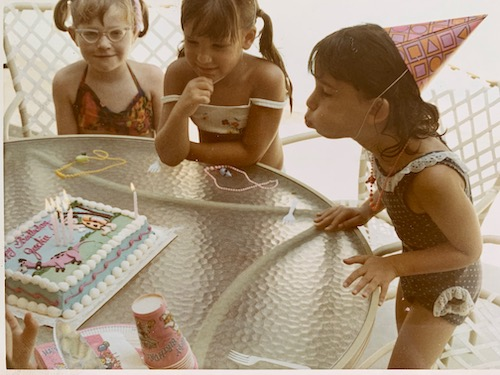My 6th birthday. A swim party in my backyard with a Flintstones cake.