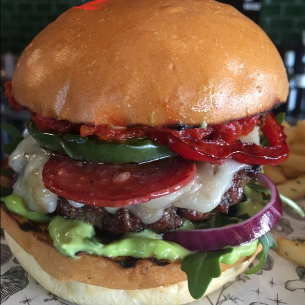 """Need something to get you through the weekend?  Not to late to get this delicious burger special 🍔🍟🍻 """"Sargent pepper"""" * 160gr Signature Blend Dry Aged Beef Patty🥩🐄 *Provolone Cheese 🧀 * Napolitana Sauce 🍅 * Sliced Pepperoni 🍕 * Grilled Peppers 🌶 * Red Onions 👌🏻 * Baby Rocket 🌿 * Basil Mayonnaise 🍃 * St Malo Milk Bun 🥖 💰$19"""