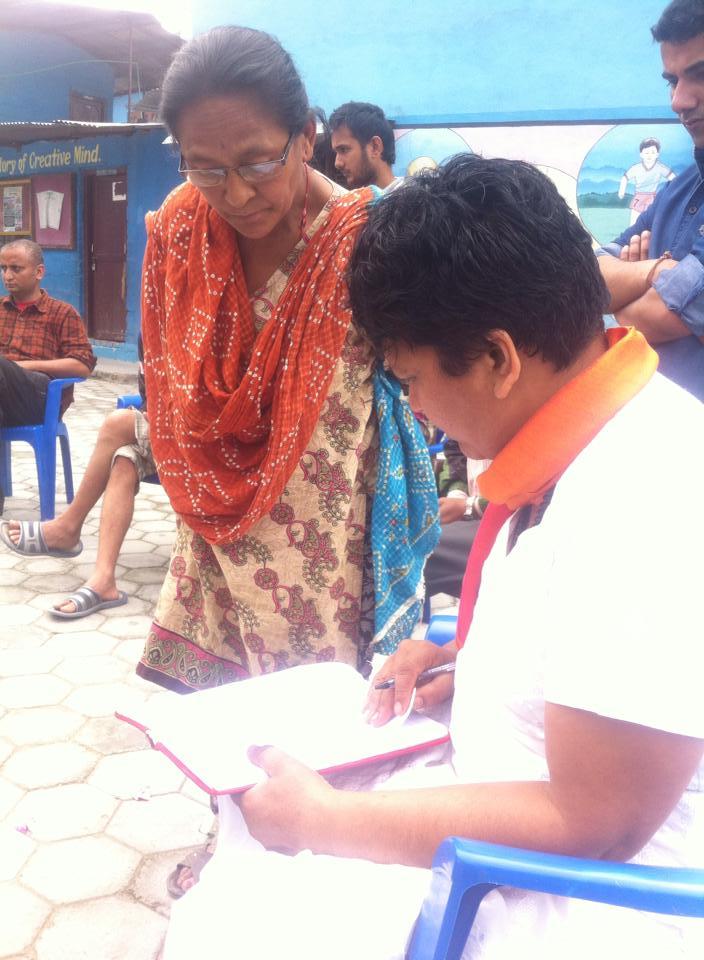 Renu planning with local women.jpg