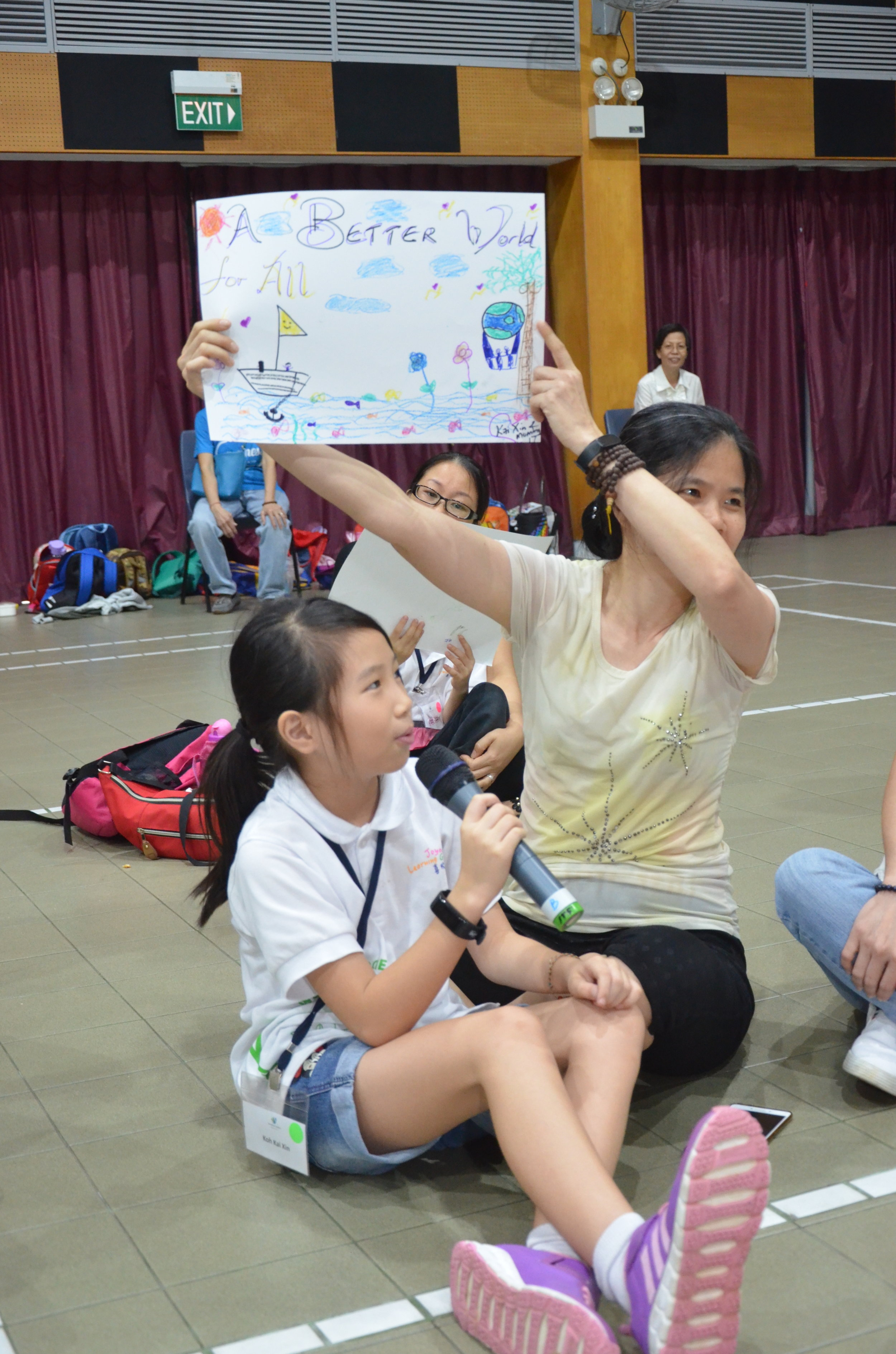 """- """"We drew a hot air balloon so that we can go around the world and give help to people who are in needs. At the same time, all the birds with hearts, we want to bring the love to everybody, whenever we go around we want them to know that we care for them."""" - Mother & Kai Xin, 10 yrs old."""