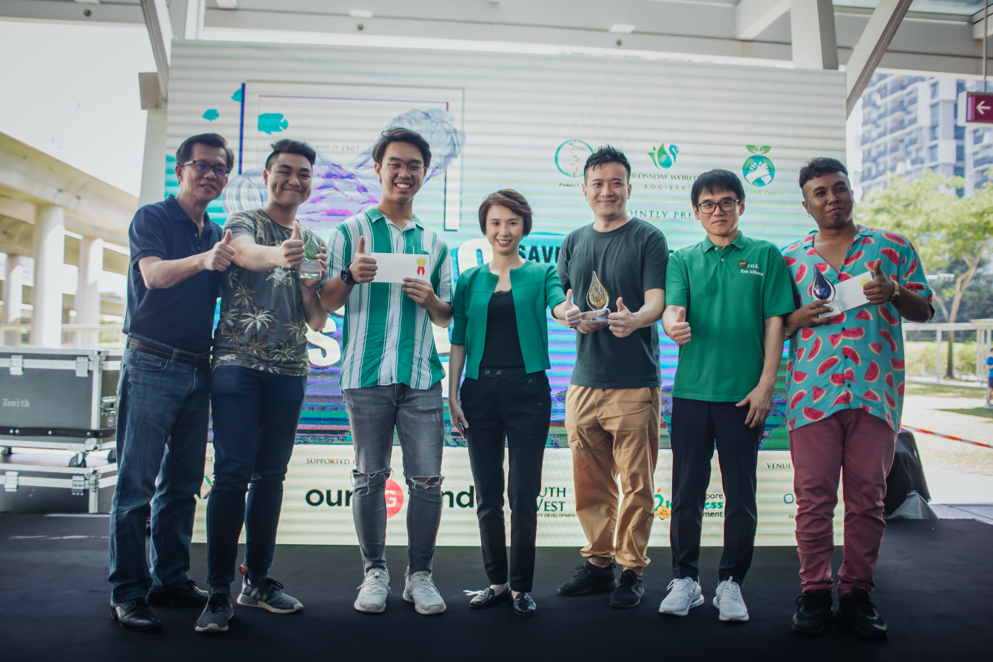 From left to right  Mr Daren Ong  (President of Blossom World Society),  Andrew Toh & Ryan Aw  (3rd place),  Ms Low Yen Ling  (Mayor of South West District),  Chen Lidi  (1st place) and  Mr Ogawa Joe  ( President of J.O.E Eco Alliance),  Muhammad Hazrulnizam Bin Azman  (2nd place)