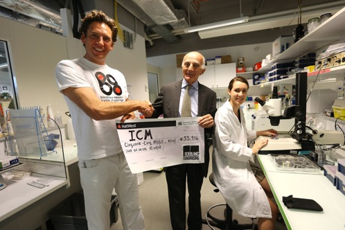 Ferblanc Founder, Henry Raker, hands over the cheque at the ICM Brain and Spine Institute.