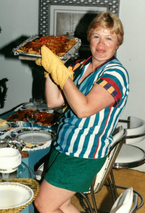 Mary Ann getting dinner on the table