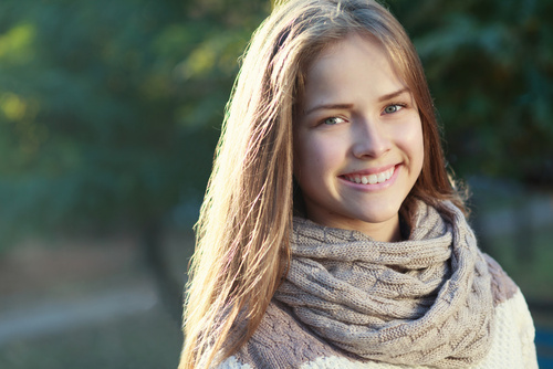 Attractive young lady smiling after having her teeth whitened