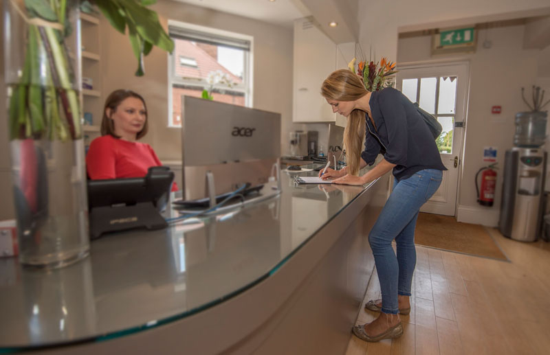 Patient at Redcliffe Dental reception desk