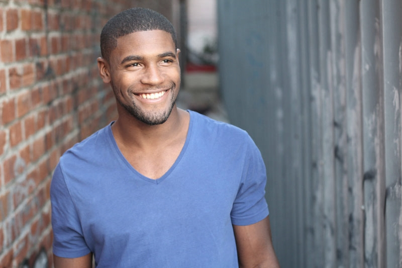 Copy of Attractive smiling black man after teeth whitening