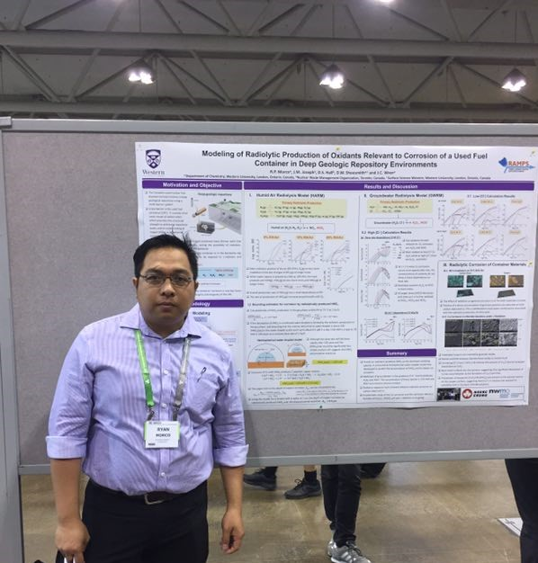 Ryan Morco in front of his poster at the CSC conference, 2017.