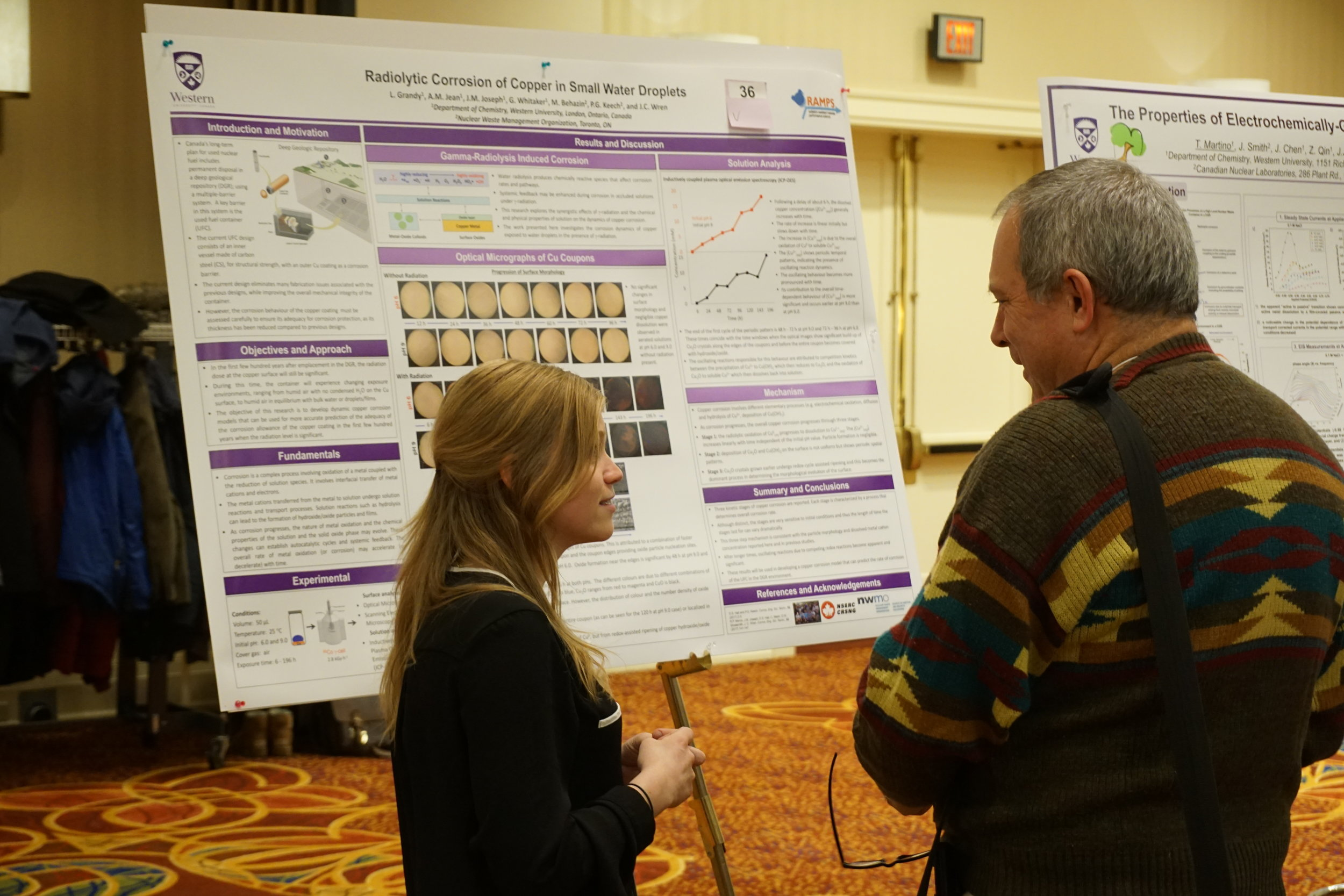 Graduate student Lindsay Grandy discussing her poster at the UNENE meeting, December 2017.