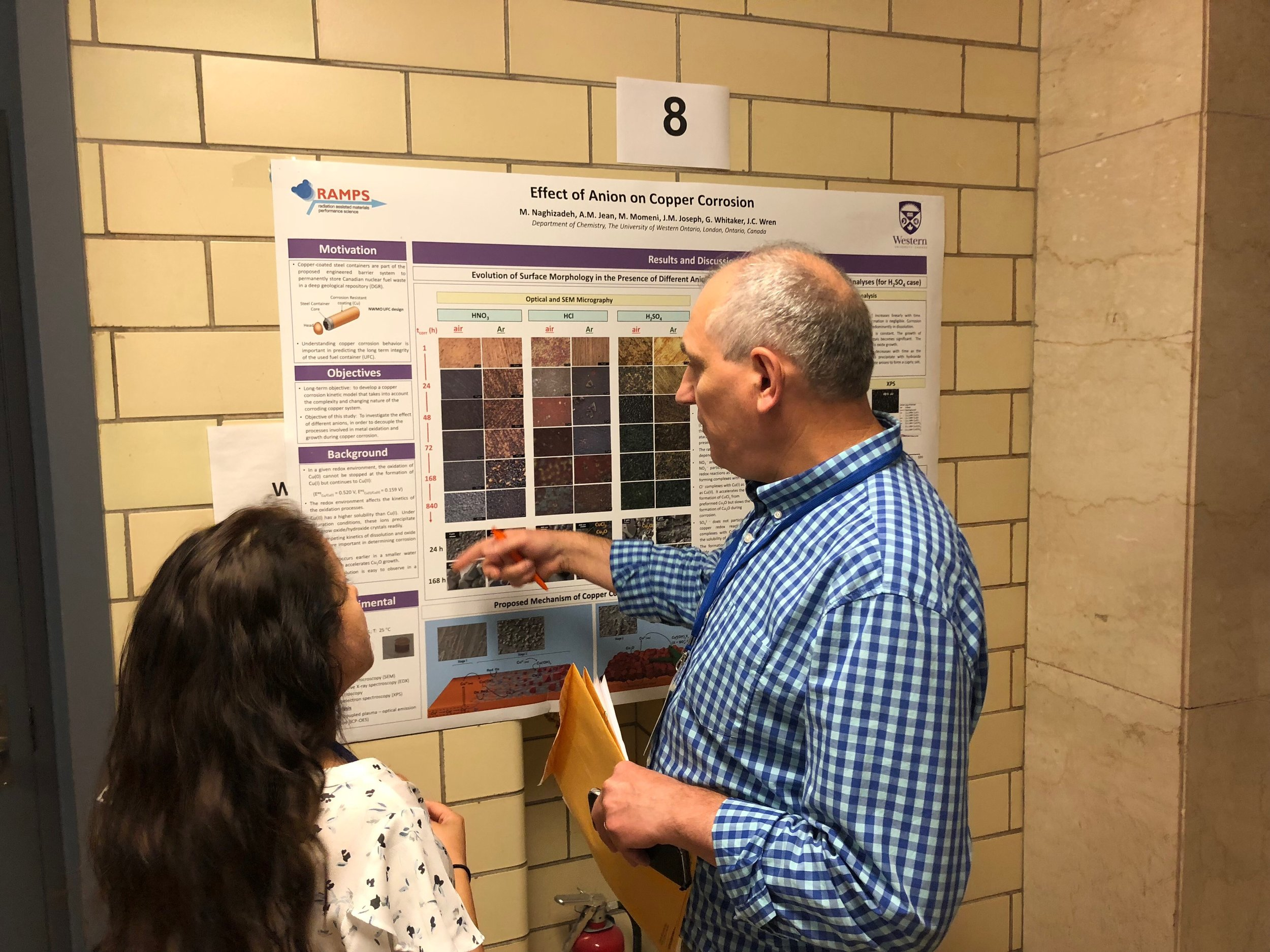 Masoumeh Naghidazeh discussing her poster at the NACE student conference, July 2018
