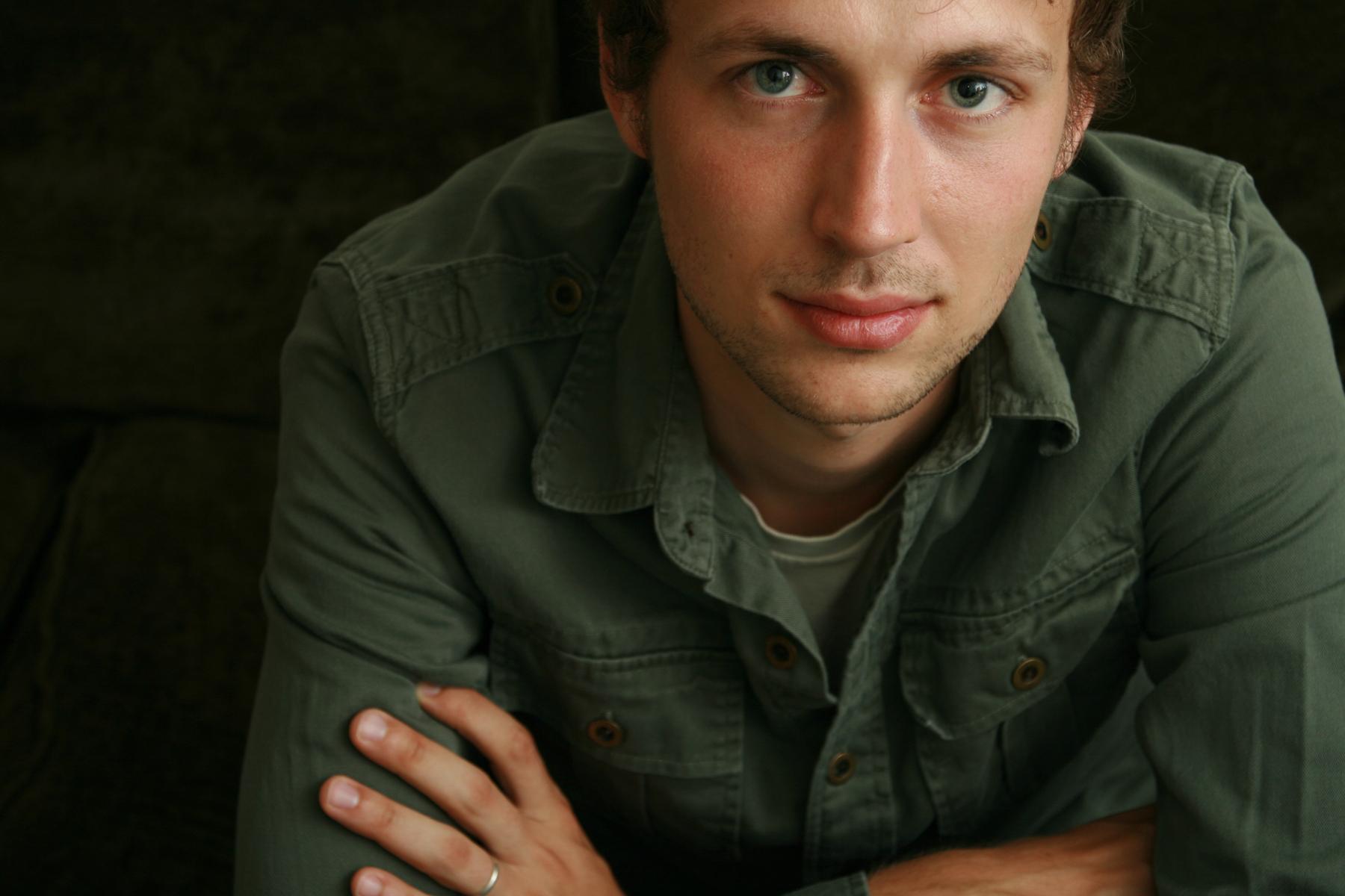 young man in green shirt on black.jpg
