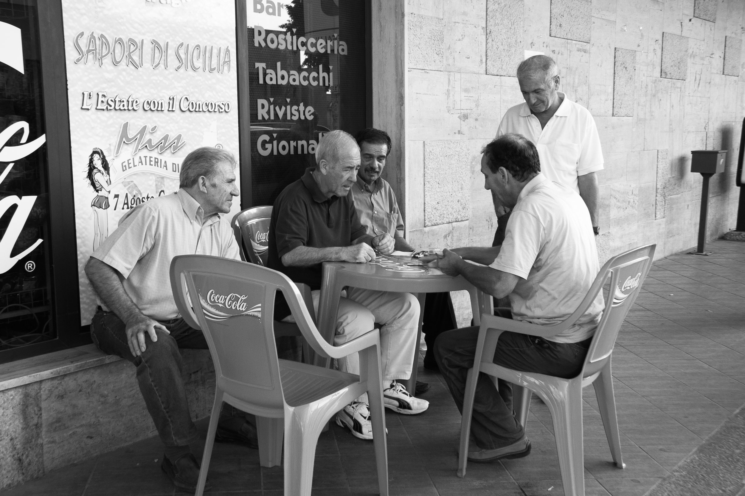 Scopone  in real life: I took this photo of these card sharks in Sicily, 2006.