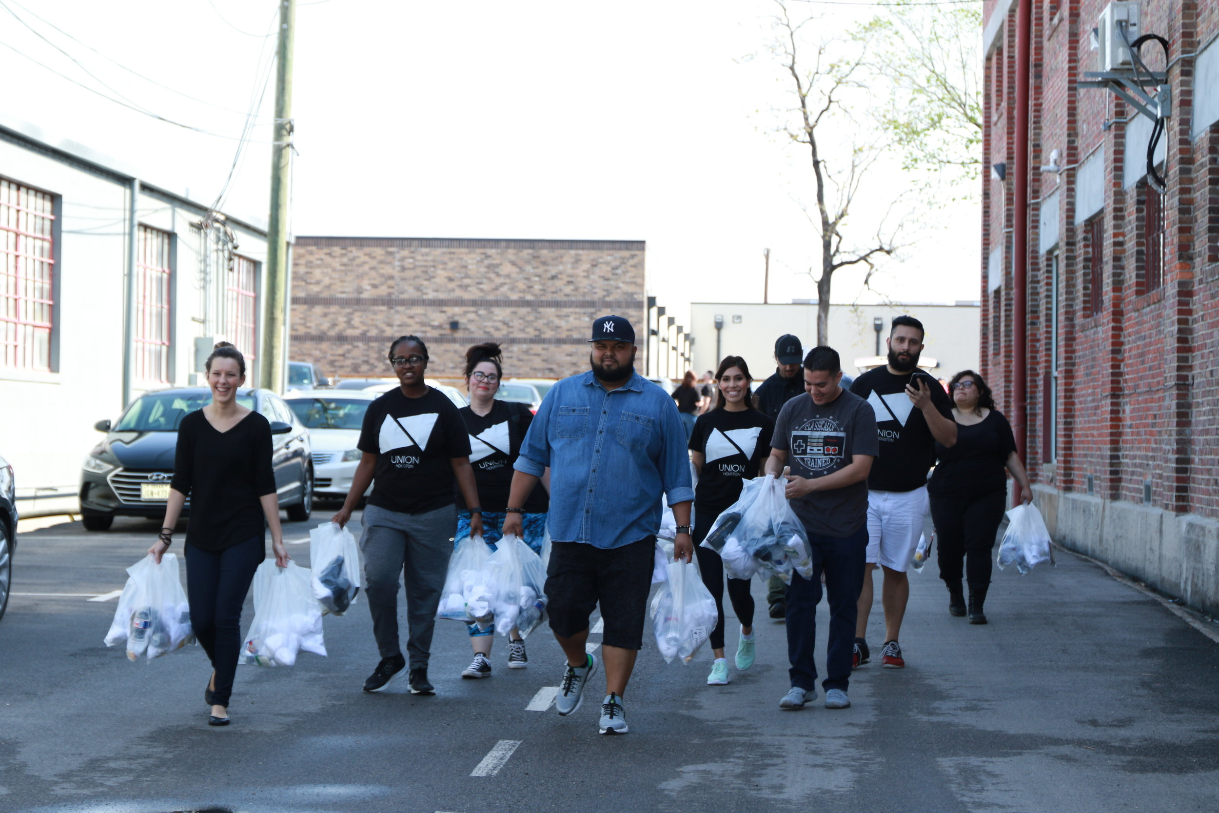 UNION Houston joined Love ONE Ministries to hand out supply bags full of socks, Hydrogen toiletries to the homeless of Downtown Houston.