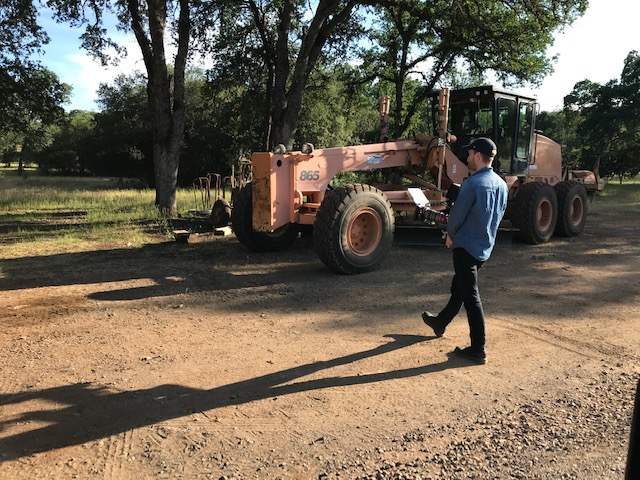 Director and DP Jethro Waters stalks a tractor