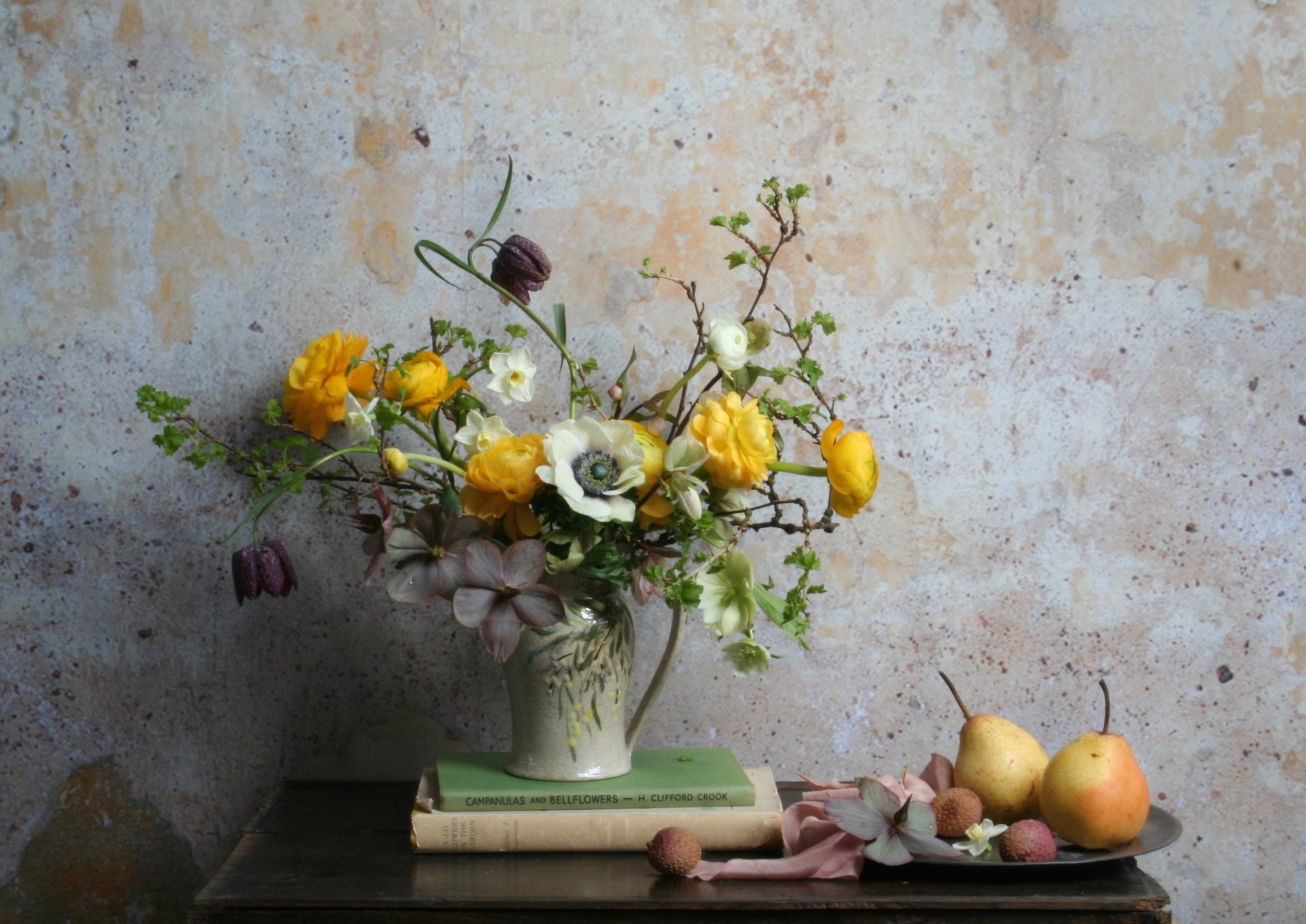 Spring palette of late Hellebores, Ranunculus, Narcissus and Anemones.