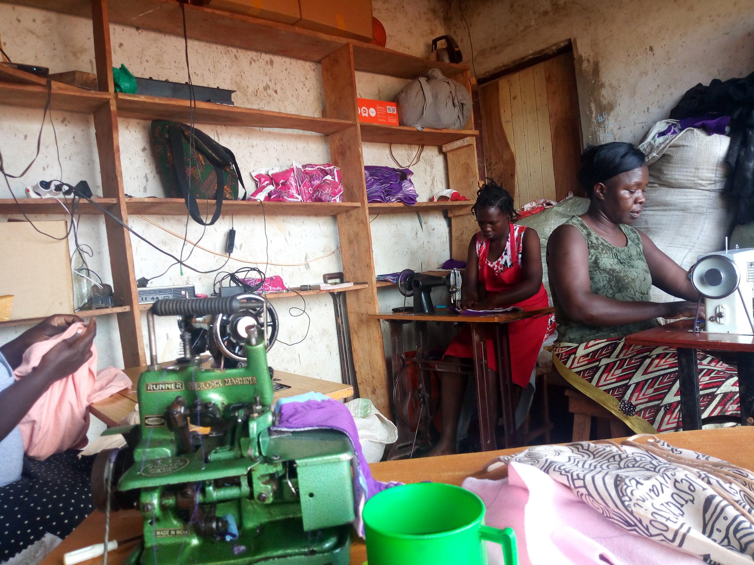 Women from RCMI making reusable pads.jpg