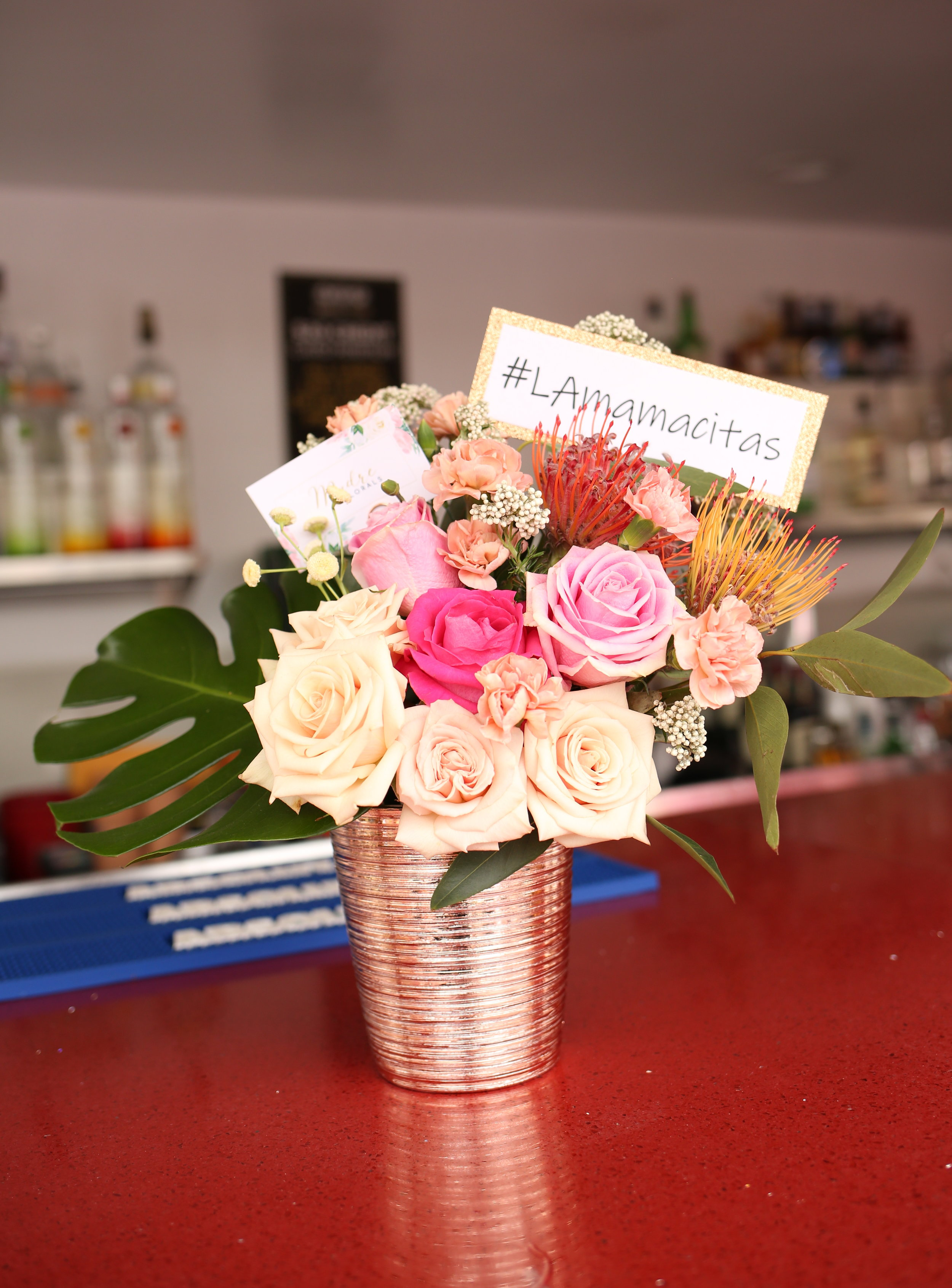 The bar got a feminine touch and make-over by  Madre Florals