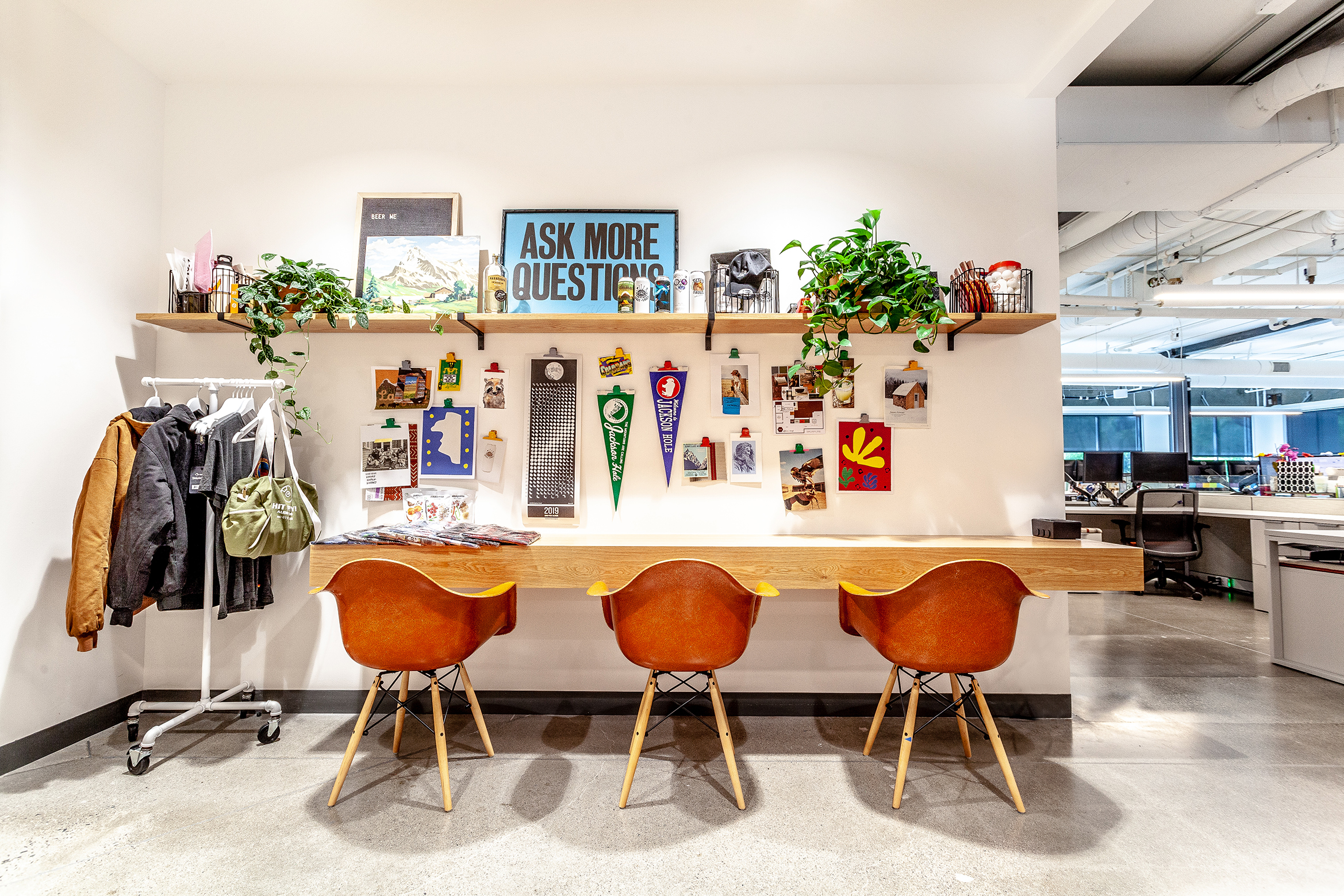"Mid-century modern style bucket chairs anchor this playful ""hoteling"" niche at Lazy Dog Cafe's corporate headquarters. Furnishings by SOURCE Creative Office Interiors."