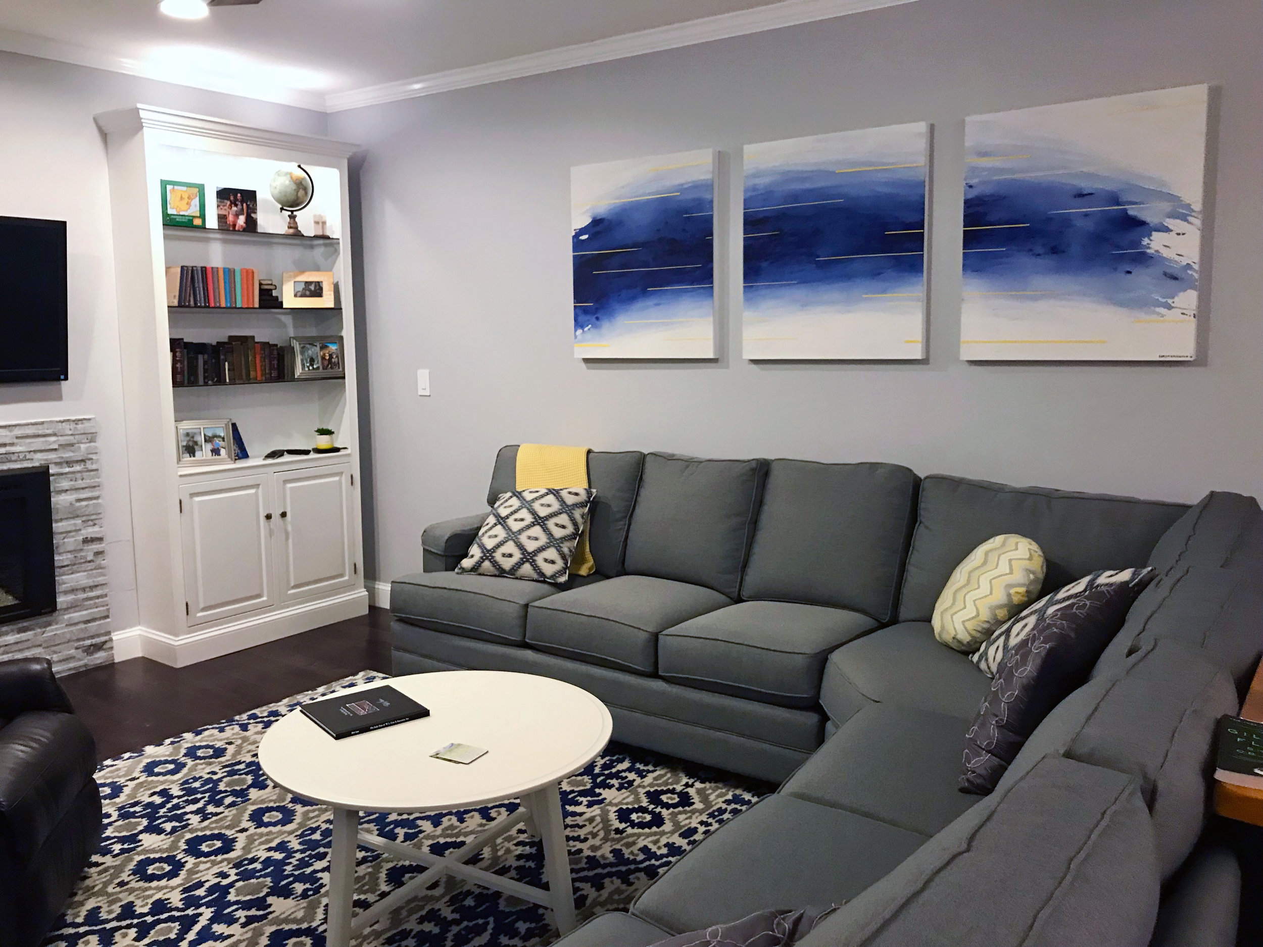 The finished panels make a great focal point in their newly renovated living room!