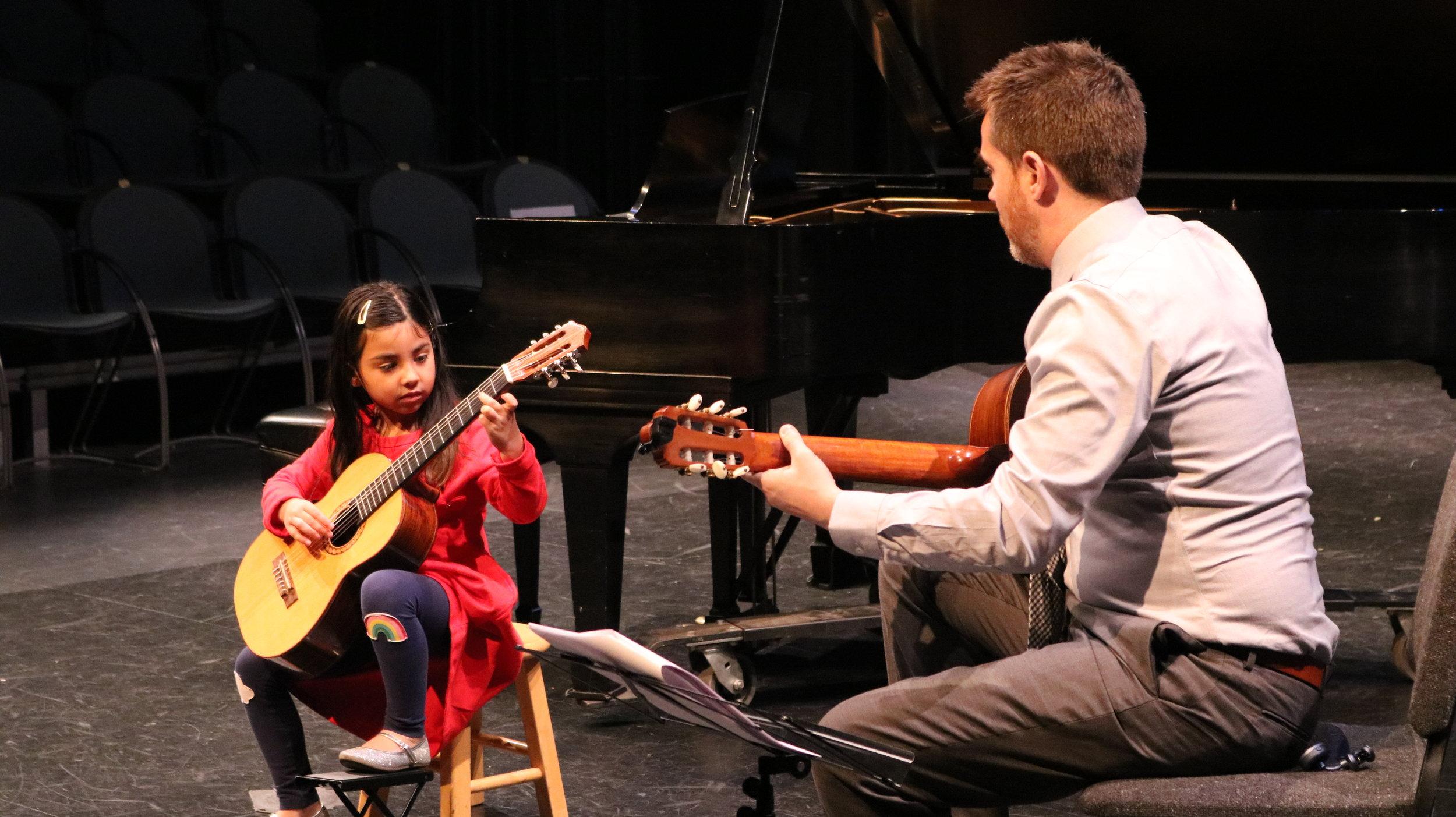 Guitar student and teacher