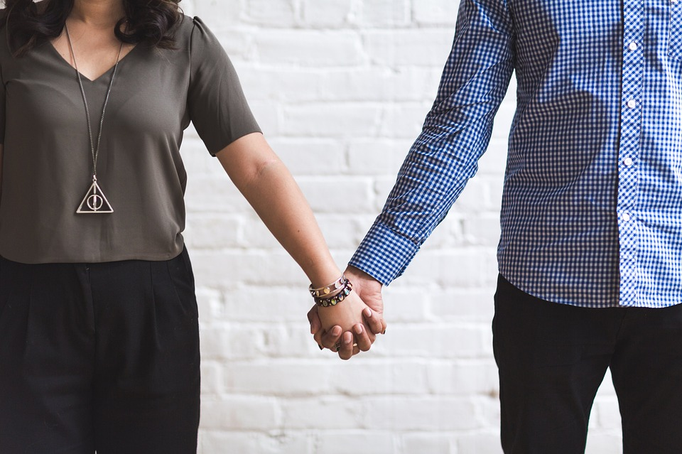 man and woman holding hands.jpg