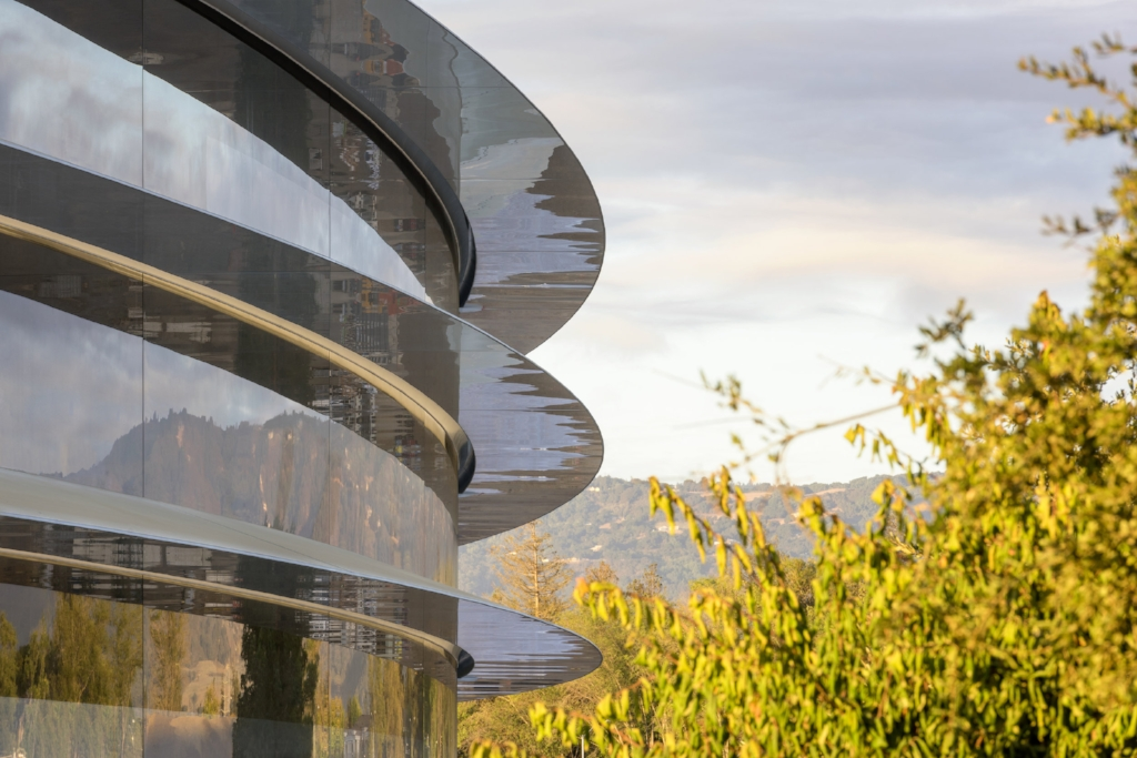 A detail of the Apple Campus main building emphasizes the curved exterior of this unique design. Photo courtesy of Apple.