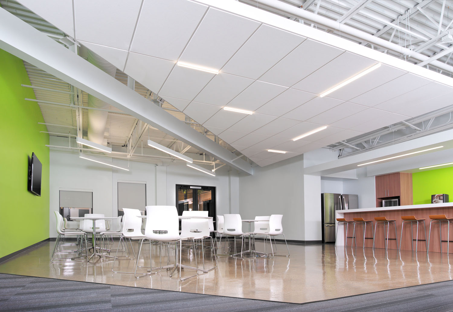 The green accent walls of the Gartner Training Center add excitement and energy to the room.