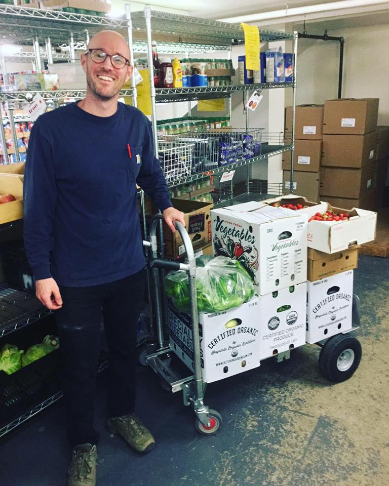 Scott Berzofsky, Food Hub Operations Coordinator, delivering fresh produce to LISTEN Community Services.