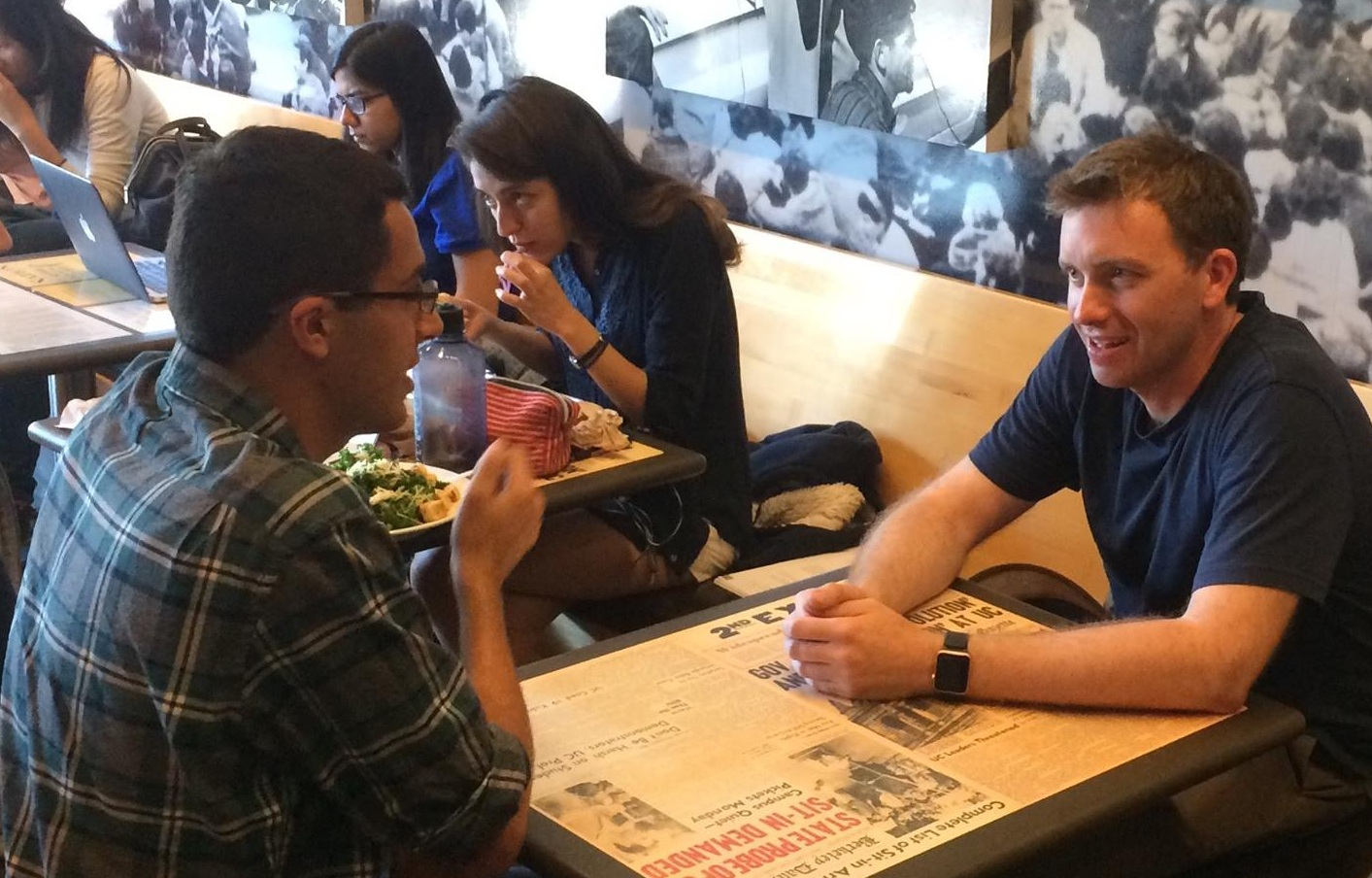 Senior Director of Studies Dr. Alexander Coward holding office hours at the Free Speech Movement Cafe.