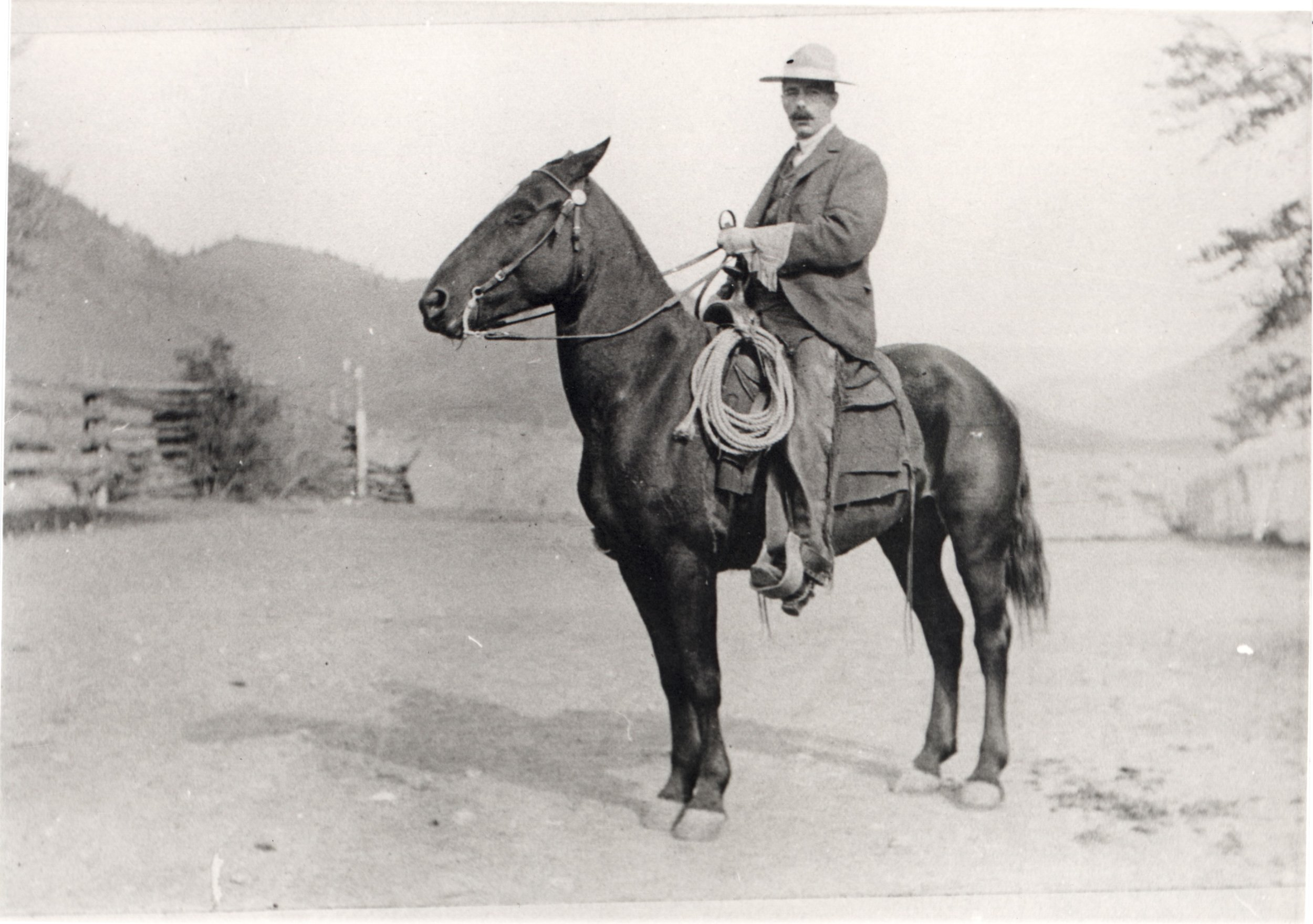 """ca. 1980. George Barclay riding his horse on the Barclay Ranch, which was used for raising cattle and horses. The ranch was also used as a school to train """"Gentleman Ranchers."""""""