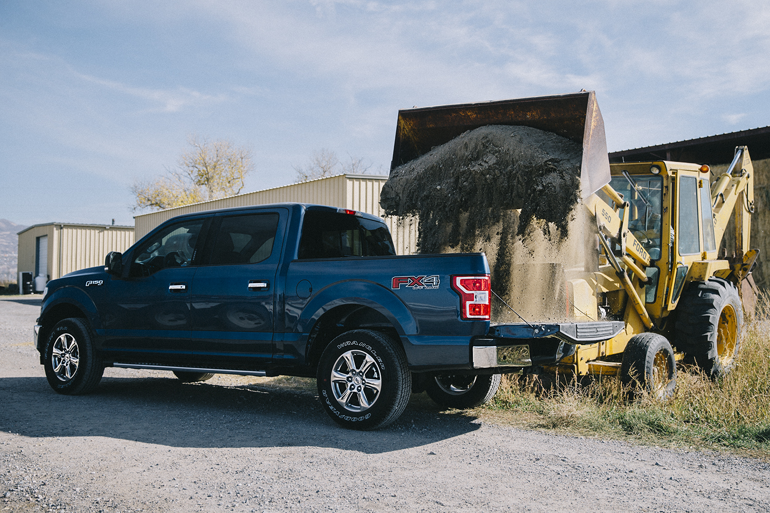 Ford F150 XLT FX4 with Tractor.jpg