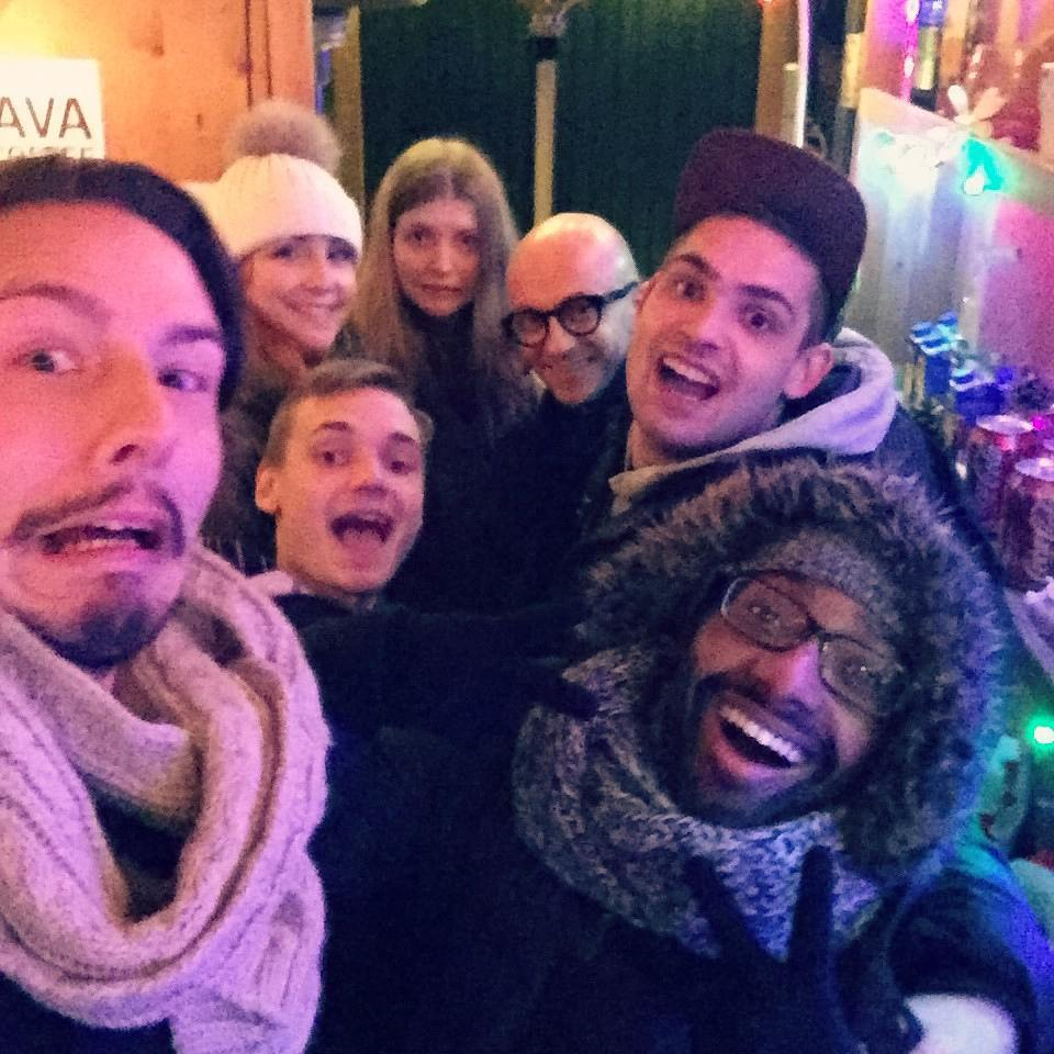 Night at the Christmas market. Robert (front left)
