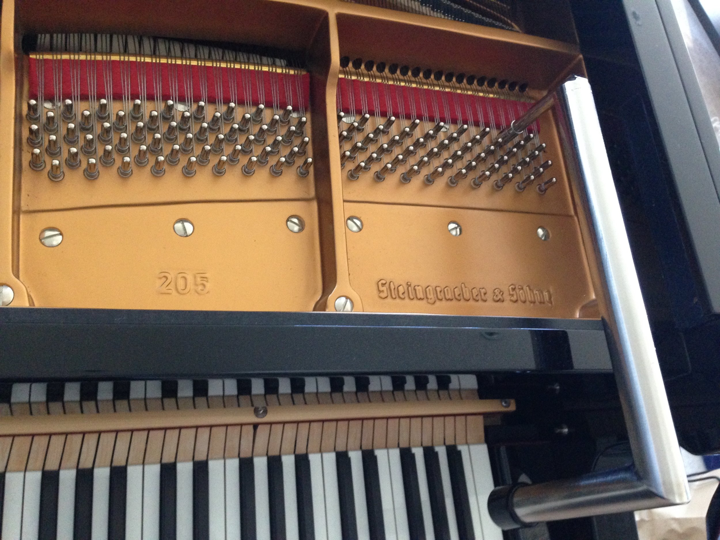 It reaches the treble pins in most large pianos...