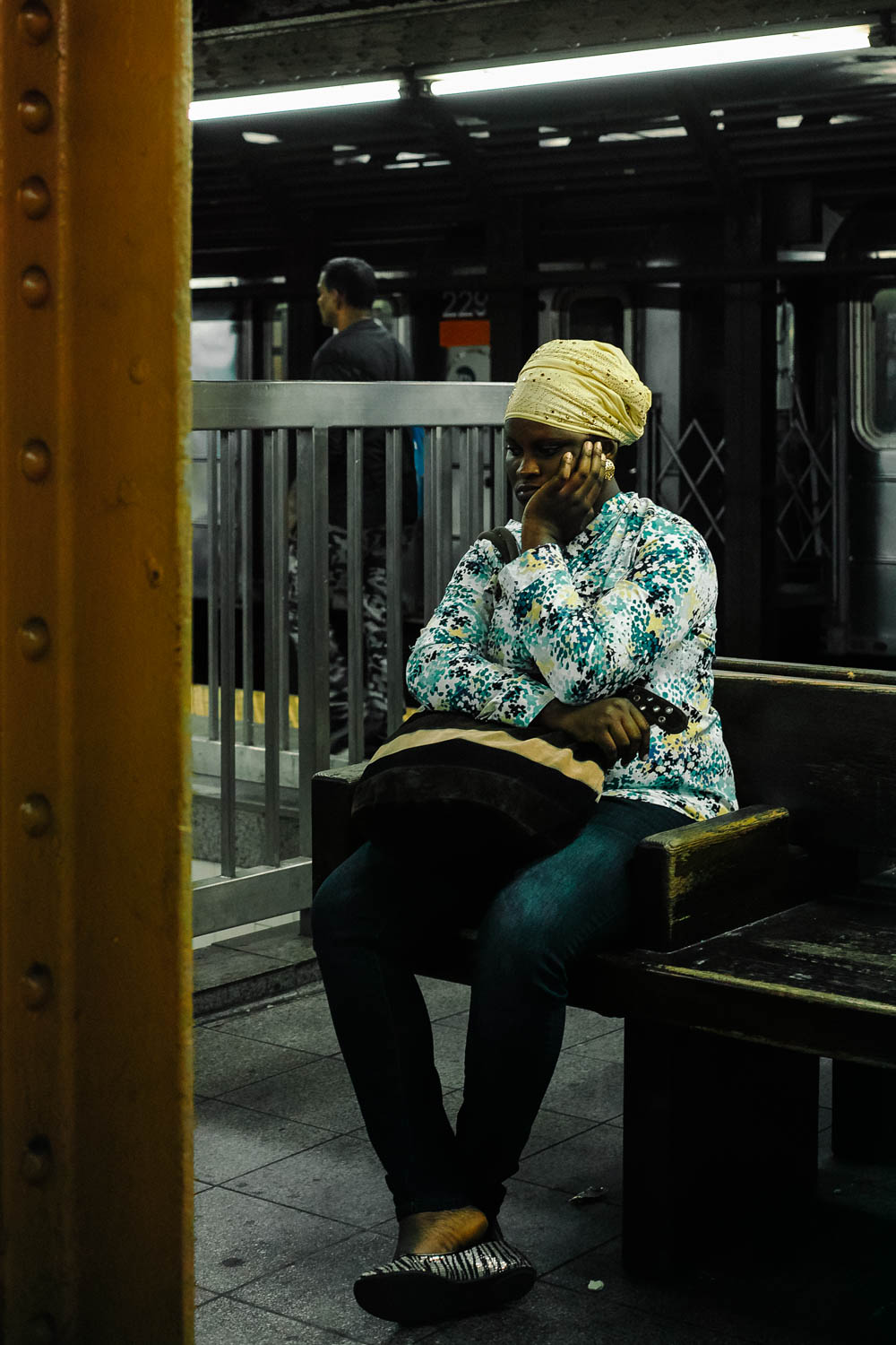 A woman waiting for the train in Times Square. Sigma DP2 Merrill, 1/60 f/2.8 ISO 200