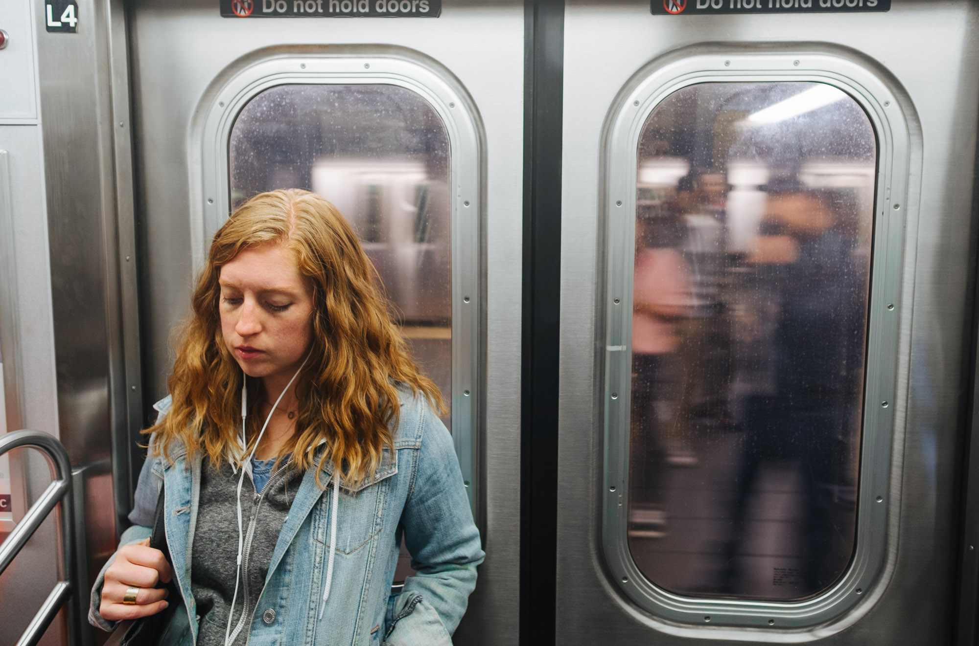A girl on the train at Fulton Street, Manhattan. Fuji X-pro1, Rokinon 12mm f/2.
