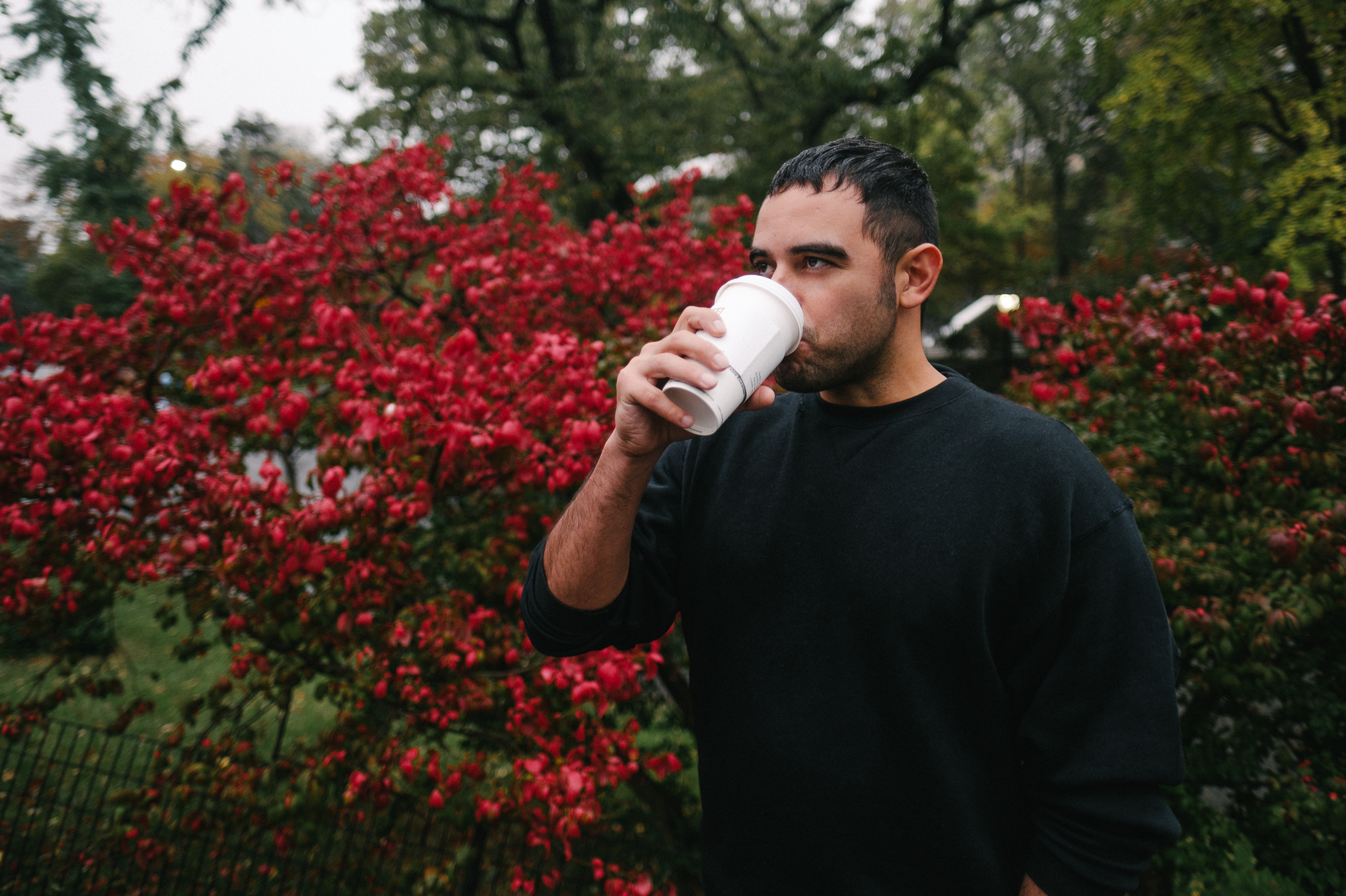 Fernando sipping coffee in Central Park. Fuji X-pro2, Fuji XF 16mm f/1.4 WR.