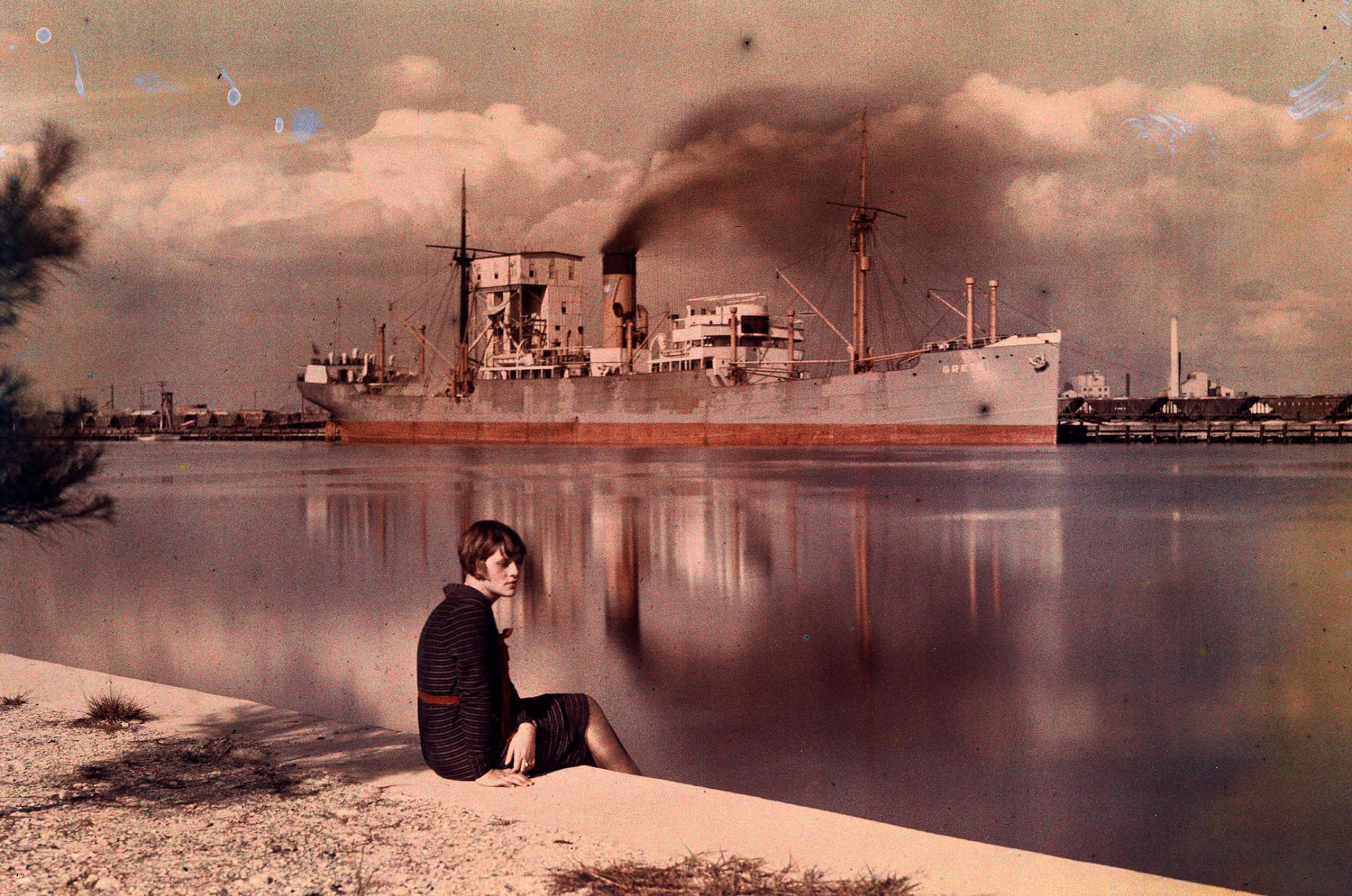 "This photo of a woman sitting on the edge of a sea wall at a harbor in Tampa, Florida, appeared in the 1930 National Geographic article ""Florida—The Fountain of Youth."""
