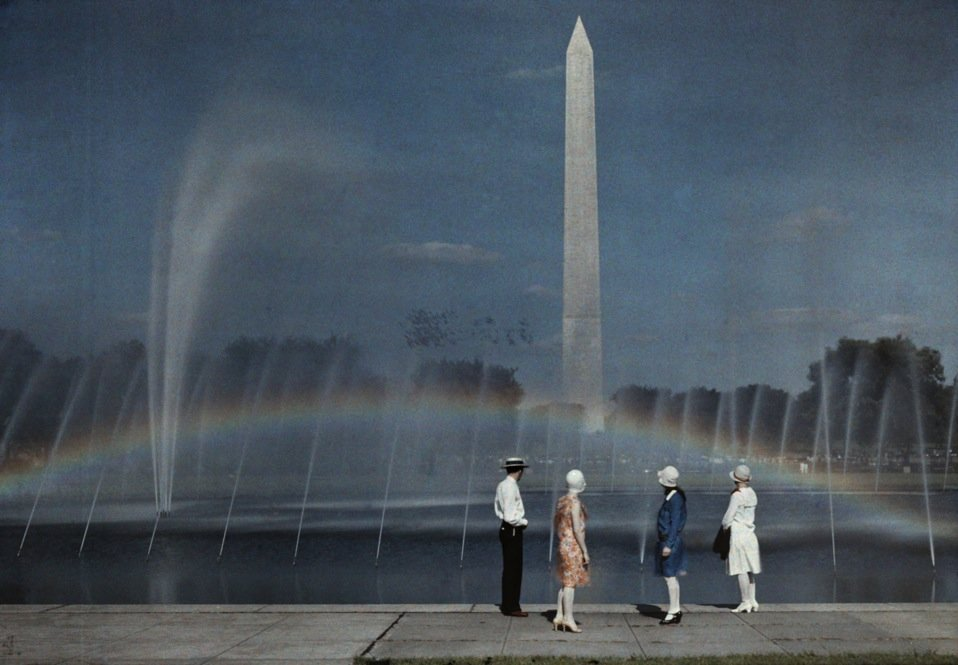 Tourists admire the Washington Monument in Washington, D.C., published 1935