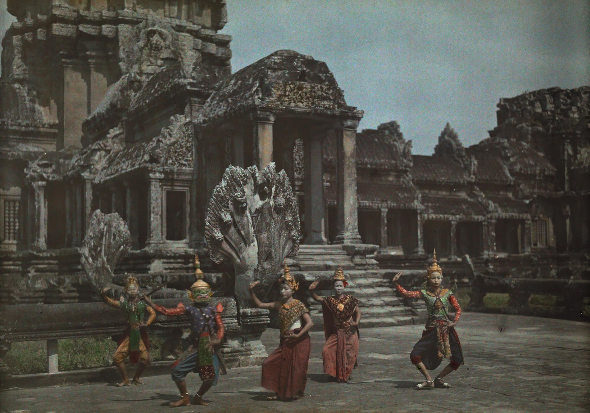Cambodian dancers in traditional clothing perform on a terrace at Angkor Wat, near Siam Reap, Cambodia. Date unknown