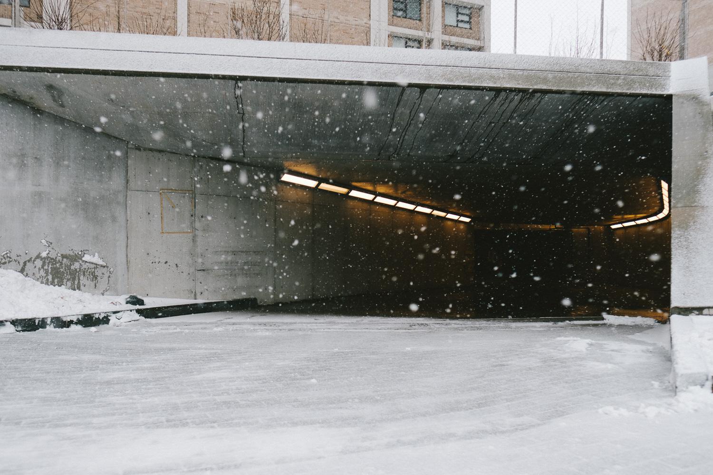 The mouth of a parking garage in Washington Heights, Manhattan.Fuji X-Pro 2, Fuji 16mm f/1.4.