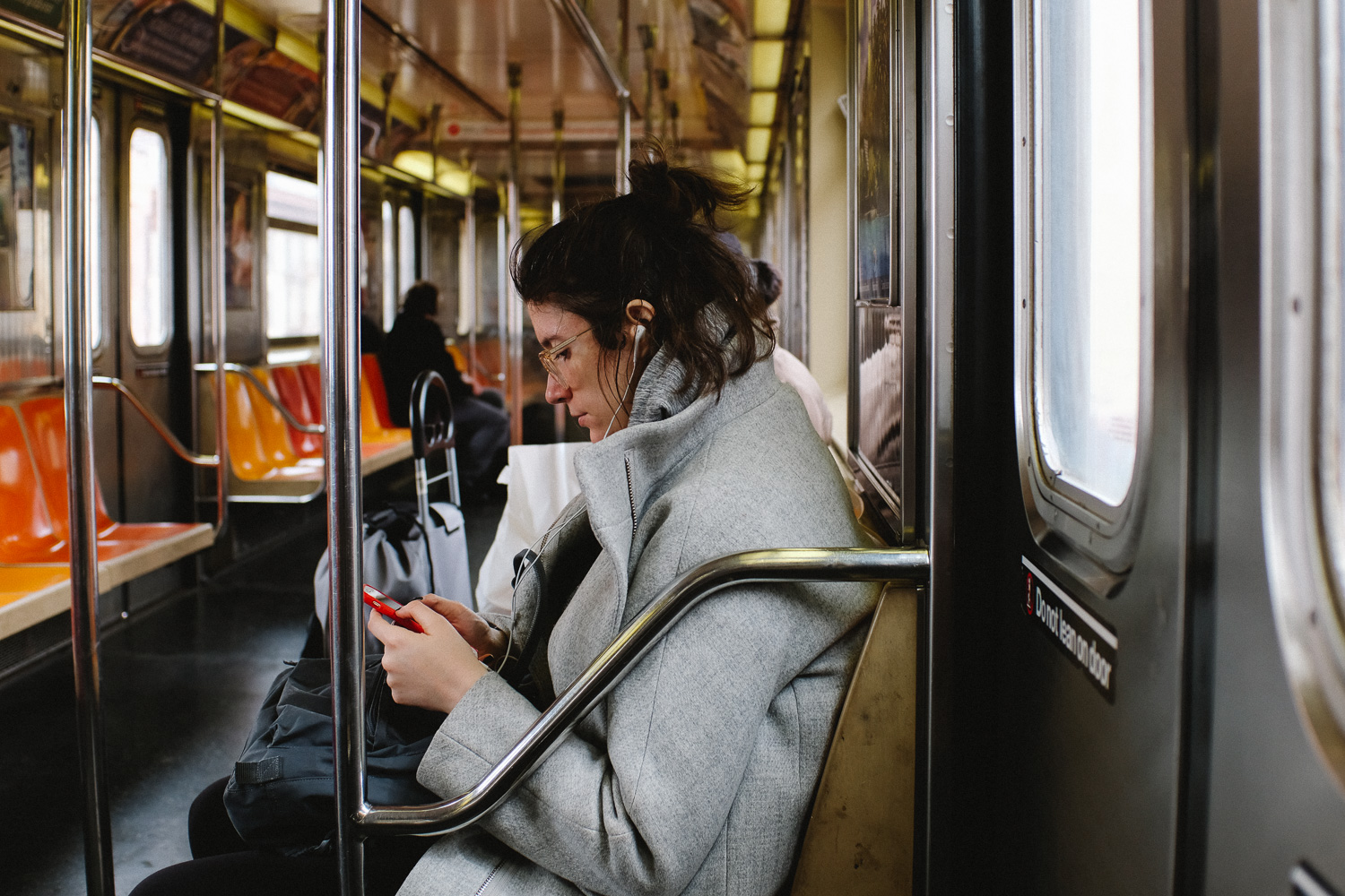 A girl on the 1 Train in Harlem, Manhattan. Fuji X100F, TCL-X100