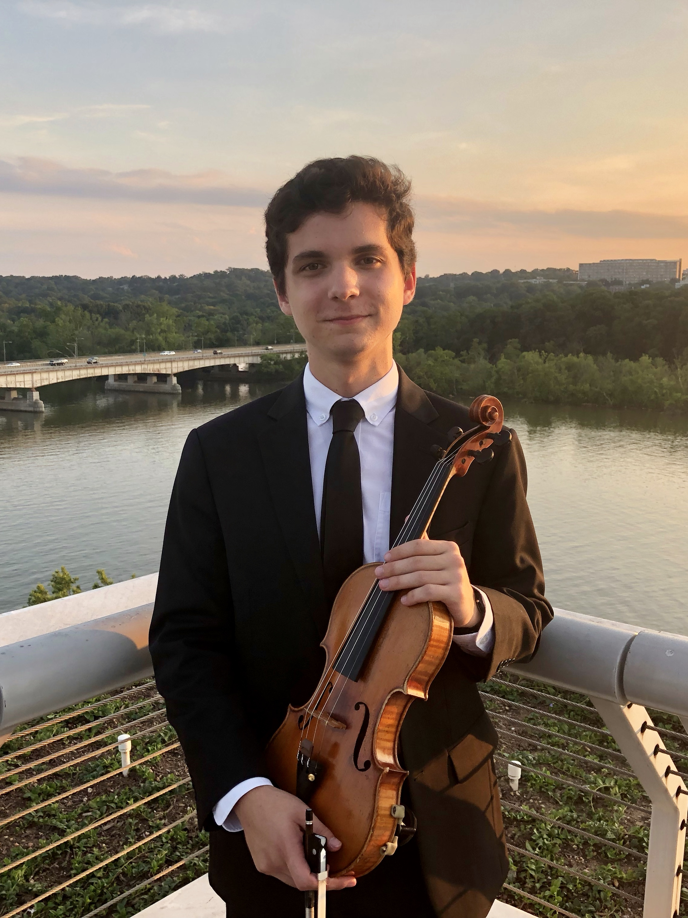 Andrew DeWeese , 17, is a rising senior at Charlotte Latin School and began studying violin at the age of 4. He has served as concertmaster in numerous orchestras, including the 2018 Honor Orchestra of America (HOOA) with Maestro Larry Livingston, the 2018 NC Western Regionals Honors Orchestra (WRO), the 2017 Philadelphia International Music Festival, and the Youth Orchestra of Charlotte. This past summer, Andrew spent four weeks as a guest artist at the John F. Kennedy Center for the Performing Arts in Washington, D.C. performing with the National Symphony's Summer Music Institute Orchestra in concerts featuring Mahler's Fourth Symphony and Strauss' Don Juan. He has also served as Assistant Concertmaster of the Youth Orchestra of Charlotte (YOC) since 2018 and as a first violinist with the 2019 HOOA, 2017 NC All-State, 2017 WRO, YOC, and Charlotte Symphony Youth Orchestra. Andrew studies with Dr. Ernest Pereira, violinist with the Charlotte Symphony and music director of the YOC, as well as with Marc Rovetti, Assistant Concertmaster of the Philadelphia Orchestra.  Especially passionate about chamber music, Andrew co-founded the Charlotte Youth String Quartet (CYSQ) in 2017 and the Charlotte Piano Trio in 2019 to address the lack of professional chamber music in the Charlotte Metropolitan Area. With the CYSQ, he organized ten community benefit concerts featuring full quartets from a variety of composers, time periods, and styles throughout the repertoire, including those of Debussy, Tchaikovsky's Third, Shostakovich's Eighth, Mozart's Third Prussian, and Villa Lobos' Fourth. The Charlotte Piano Trio put on its first concert in the summer of 2019, featuring Brahms' First Piano Trio, Shostakovich's Second, and the North Carolina premiere of Servais' Grand Duo de Concert No. 2 for Violin and Cello. Andrew has vigorously sought to make more known the repertoire of violin and cello duos, having performed Ravel's Duo over twenty times as well as duos of Kodály, Villa Lobos, and Bach.  Andrew has also performed in orchestras on tour at the Sydney Opera House in Australia, New York's Carnegie Hall, New York, as well as throughout North and South Carolina, Pennsylvania, Florida, and Indiana. He participated in a promotional video filmed and broadcasted by the NFL's Carolina Panthers and is a percussionist in the Charlotte Latin School Pep Band.  Outside music, Andrew enjoys studying classical languages and chemistry. He has spent two summers working with Dr. Socha at Illium Labs/Queens University and has co-authored a paper published in the Journal of Industrial & Engineering Chemistry. He studies Attic Greek, Homeric Greek, and Latin, and especially loves the works of Thucydides, Vergil, and Plato. Andrew is Student Body President of Charlotte Latin School and serves regularly on the school's Model United Nations team at conferences across the nation.