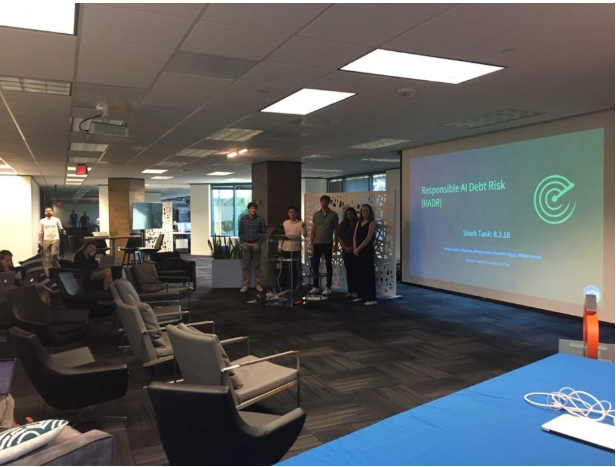 My intern team pitching our Shark Tank project at All Hands!