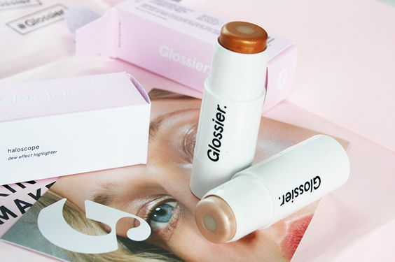 5. GLOSSIER CRYSTAL INFUSED HIGHLIGHER/ HALOSCOPE in TOPAZ  #PurchaseHere and use my code for an additional 10% off!   http://bff.glossier.com/gMpCH