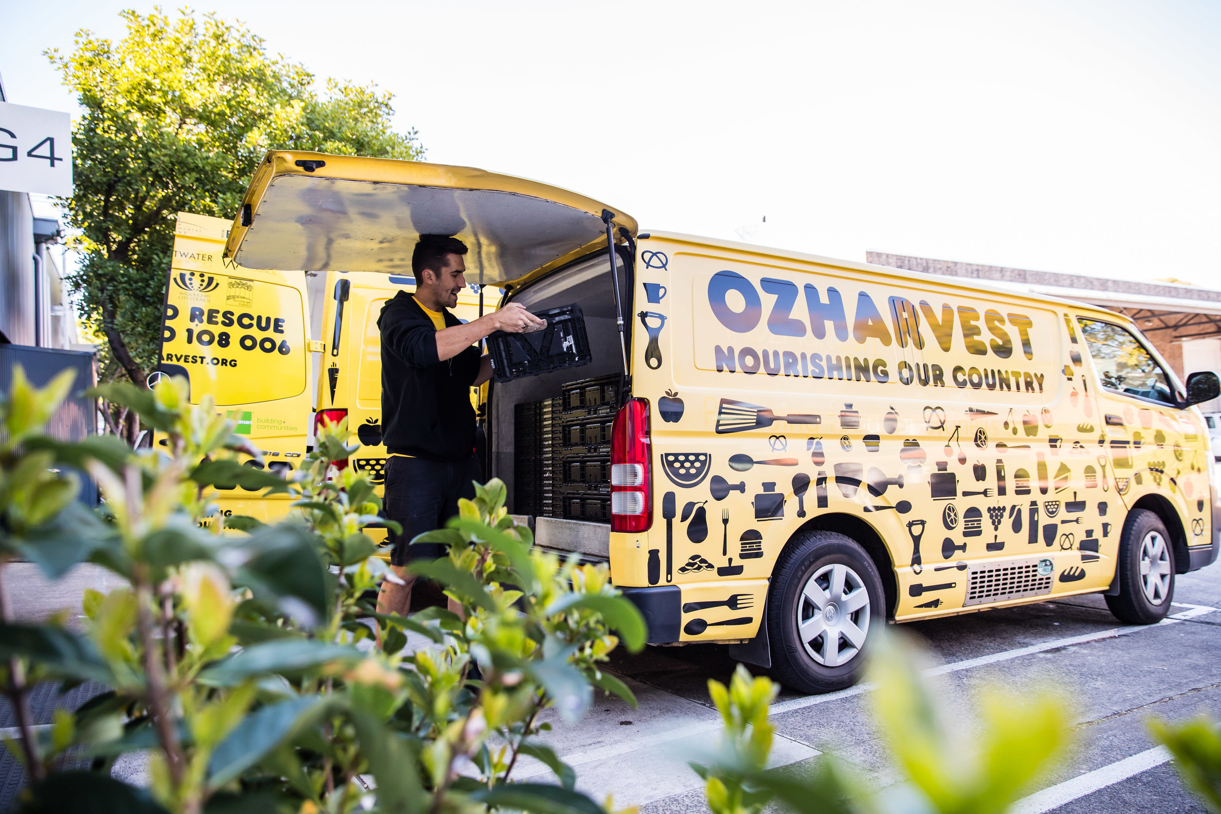 One of OzHarvest's big yellow vans.  Photo by Nikki To.