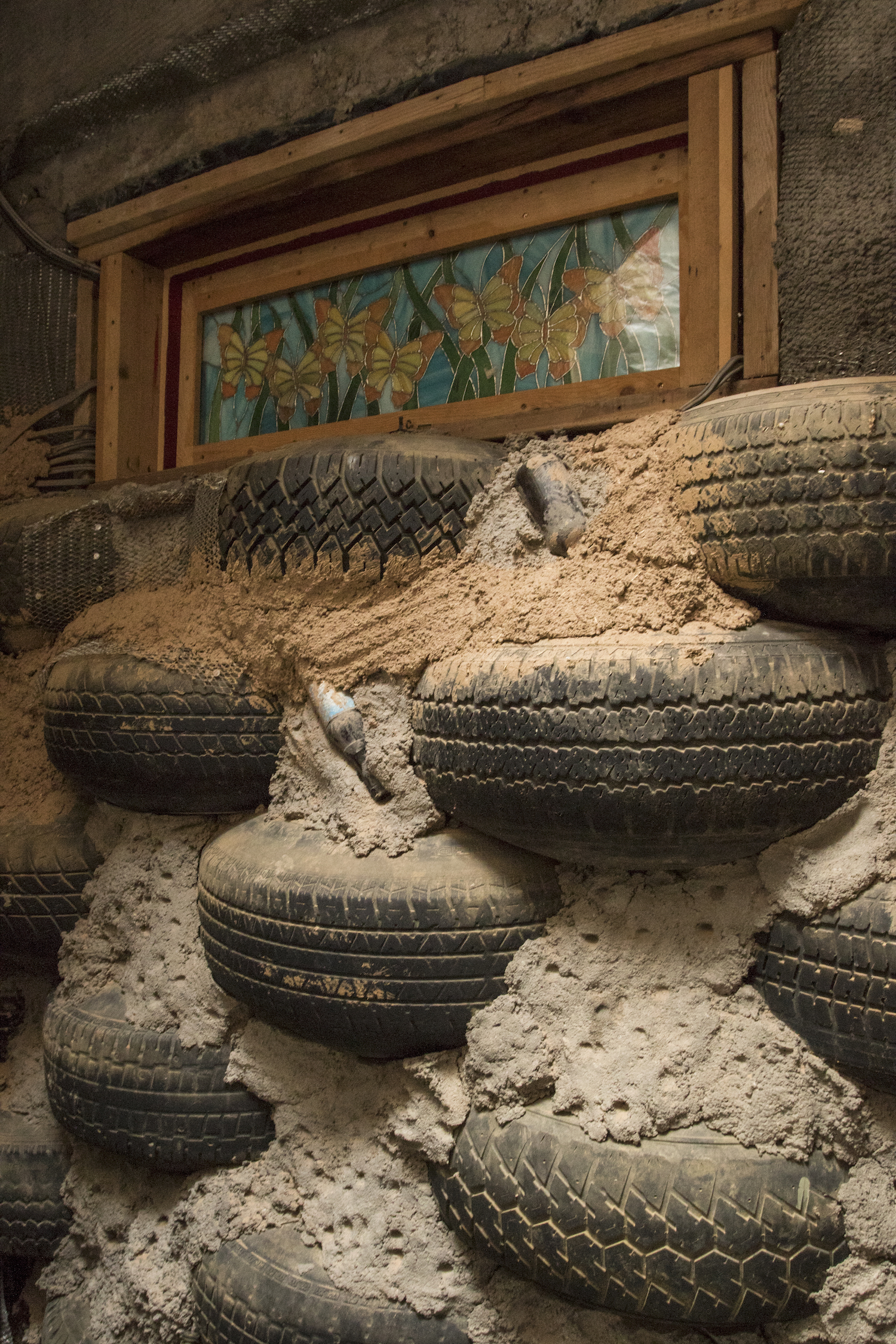 A classic Earthship feature wall. Taos, New Mexico.