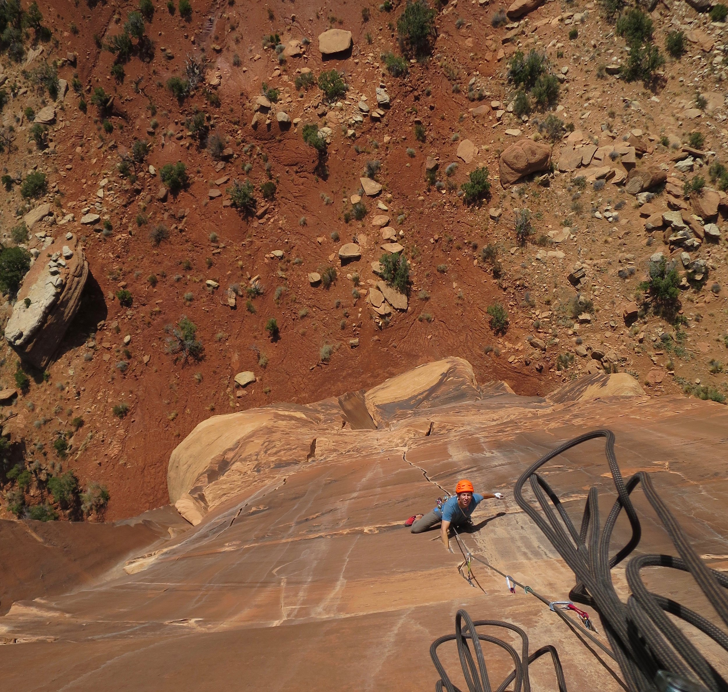 Jonathon Spitzer coming up to the belay on Medicine Man on Sentinal Spire in Colorado National Monument