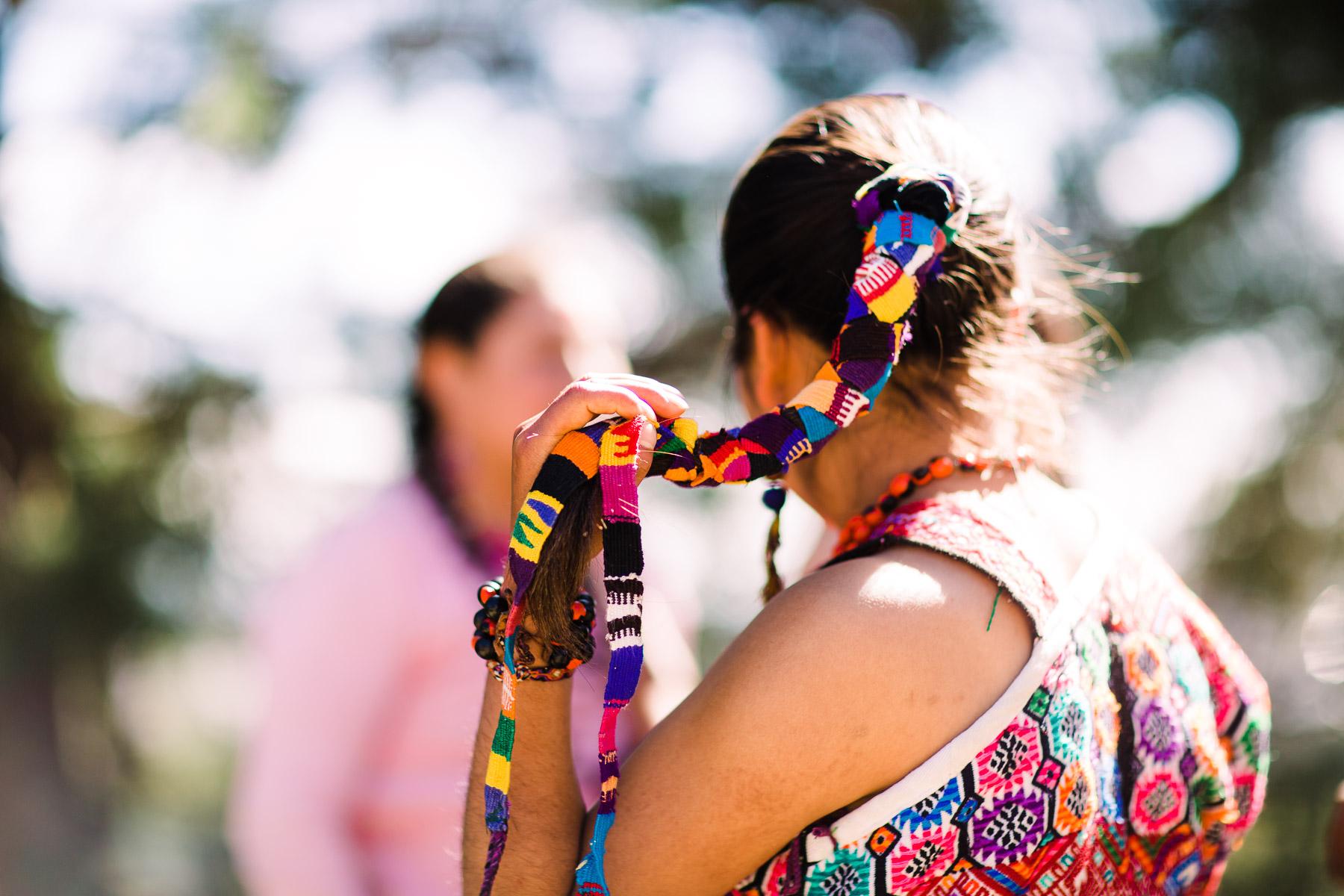 Moloj Wa'ix Ejqalem performance preparation colorful hair tie