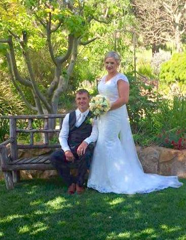 wedding couple relaxing in garden copy.jpg